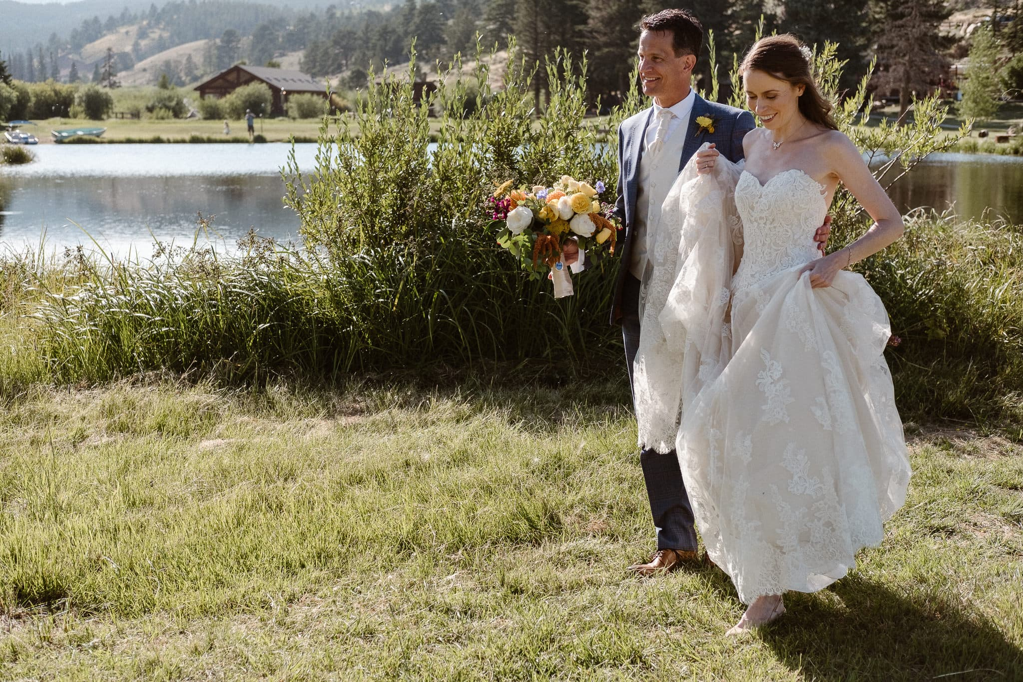 Red Feather Lakes elopement photographer, Colorado intimate cabin wedding, bride and groom hiking through alpine meadow