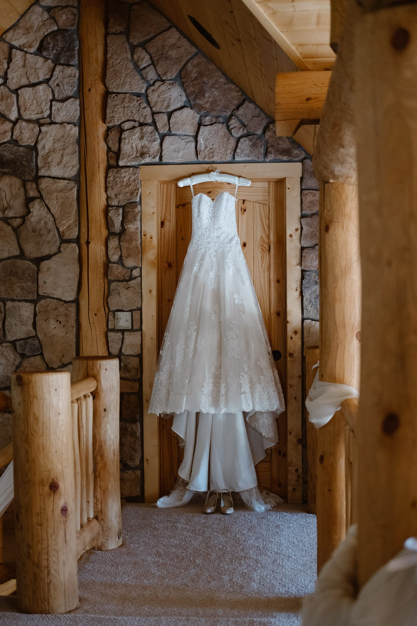 Red Feather Lakes elopement photographer, Colorado intimate cabin wedding, classic wedding dress with long train