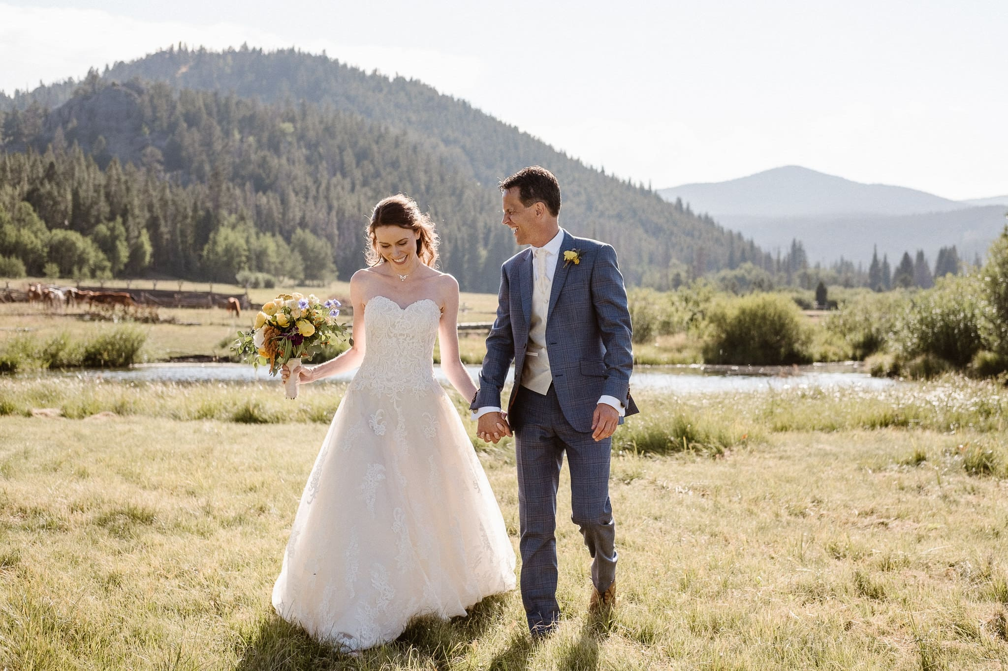 Red Feather Lakes elopement photographer, Colorado intimate cabin wedding, bride and groom portraits in mountain meadow, candid wedding portraits
