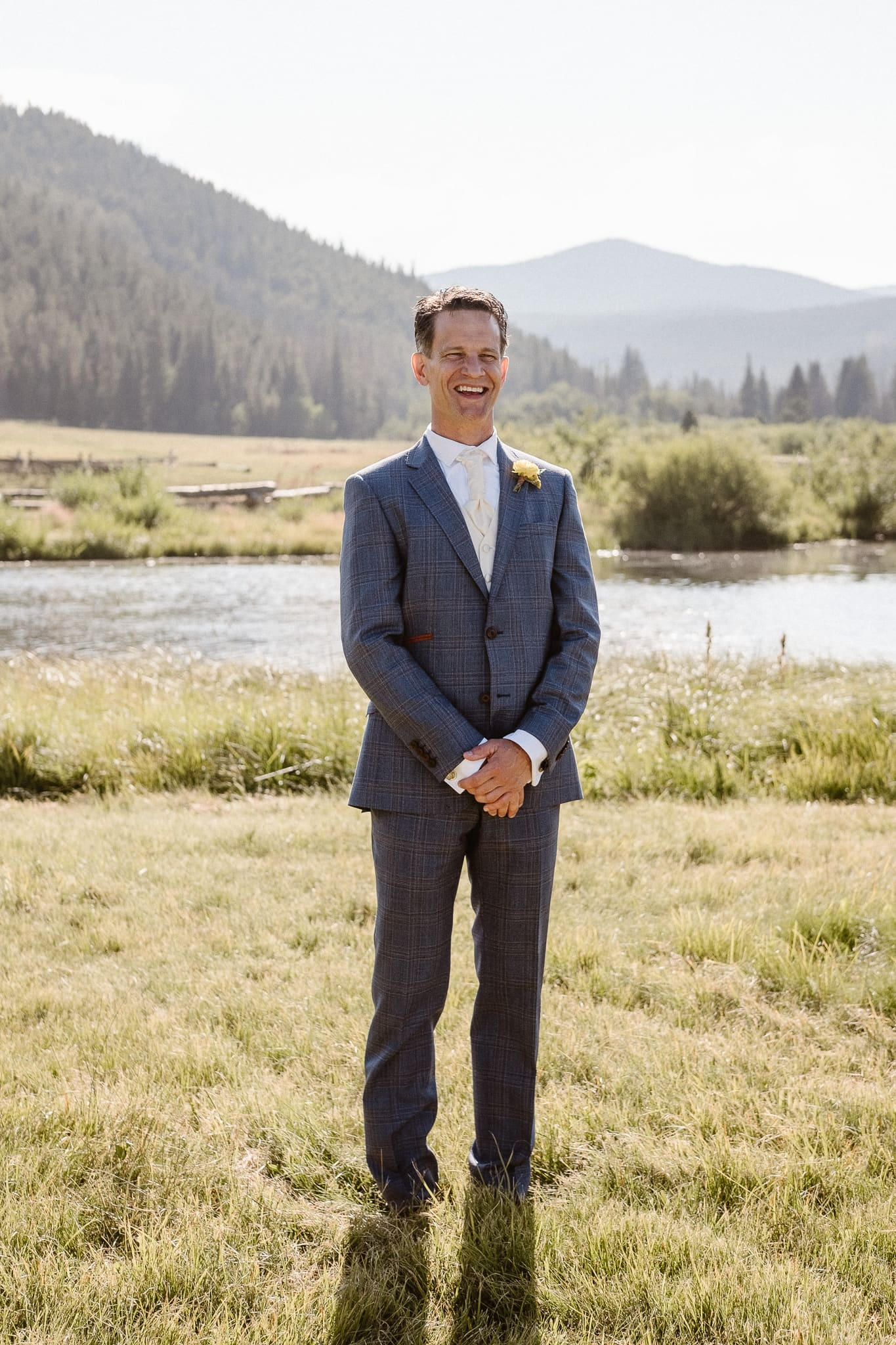 Red Feather Lakes elopement photographer, Colorado intimate cabin wedding, groom portraits in mountain meadow, groom in blue suit