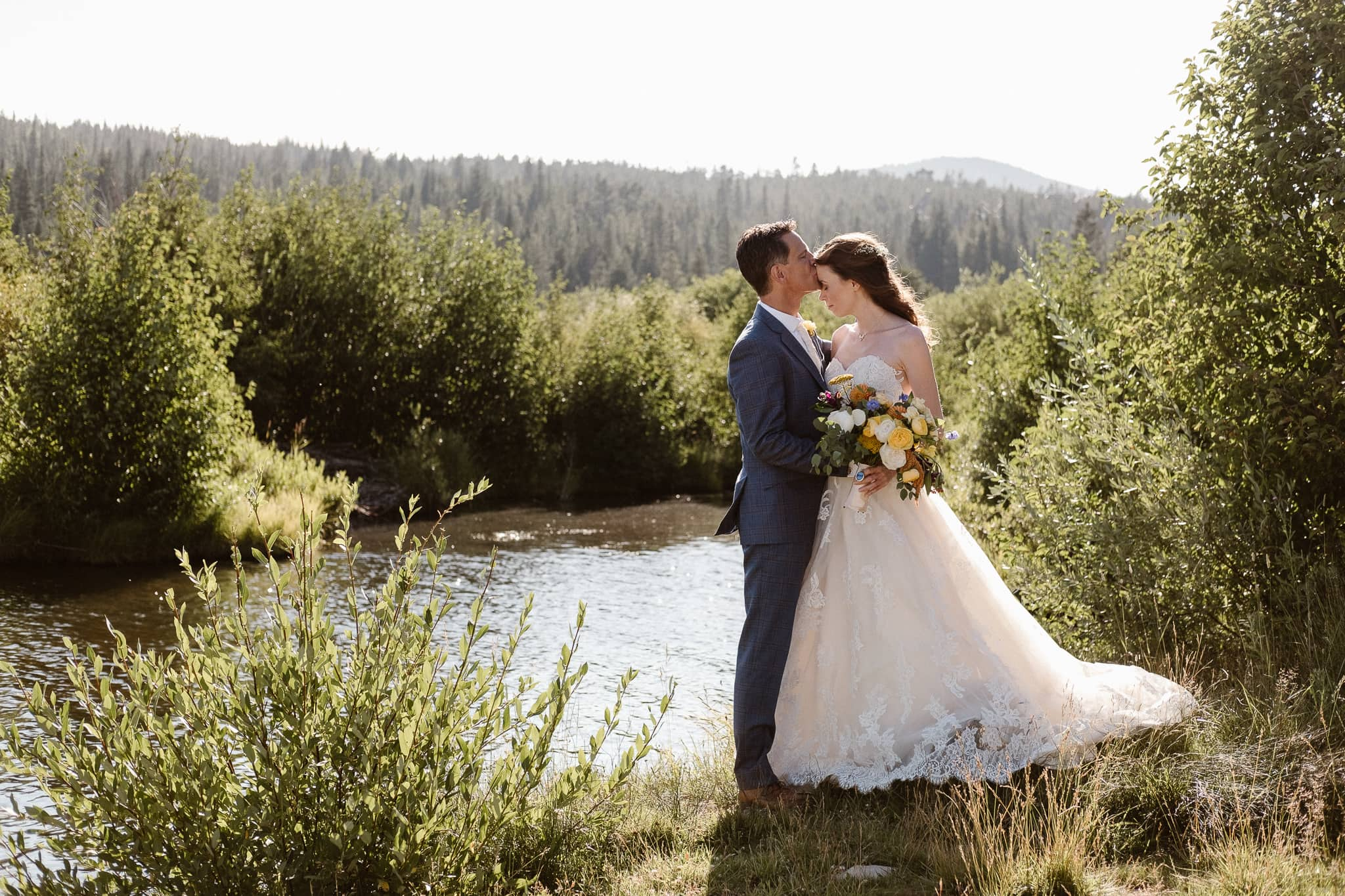 Red Feather Lakes elopement photographer, Colorado intimate cabin wedding, bride and groom portraits by mountain creek