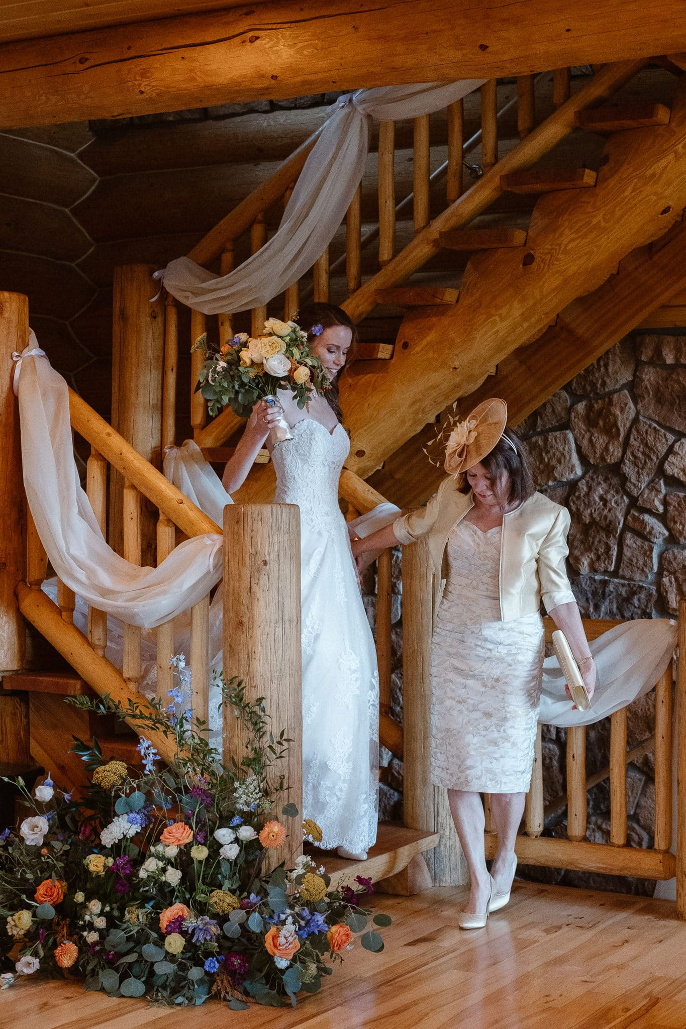 Red Feather Lakes elopement photographer, Colorado intimate cabin wedding, bride walking down stairs