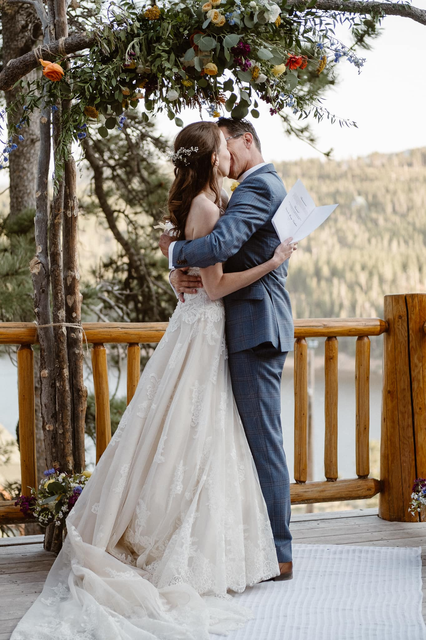 Red Feather Lakes elopement photographer, Colorado intimate cabin wedding, cabin wedding ceremony, bride and groom first kiss