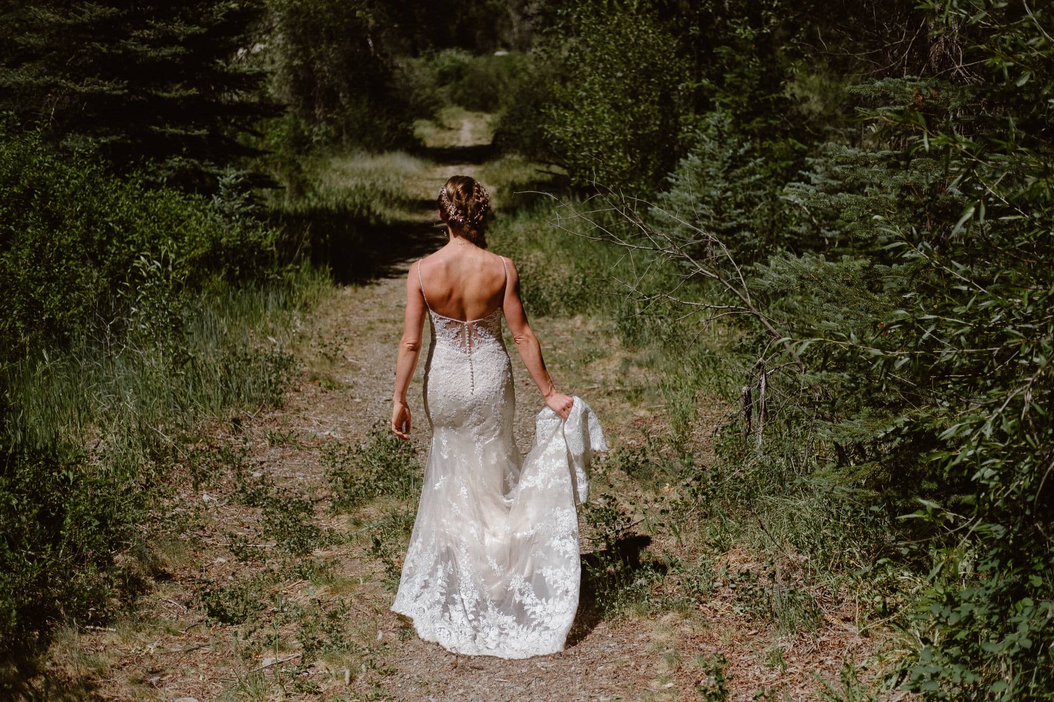 Redstone Inn wedding photographer, Carbondale wedding photographer, Colorado intimate wedding photographer, bride walking down trail to first look
