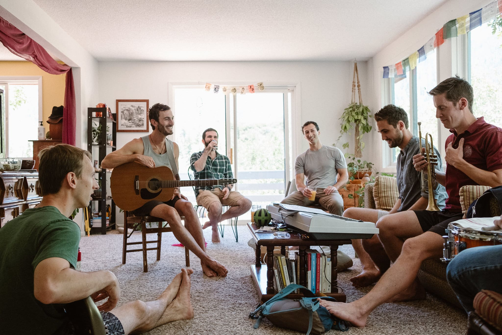 Redstone Inn wedding photographer, Carbondale wedding photographer, Colorado intimate wedding photographer, groom and groomsmen playing guitar and getting ready