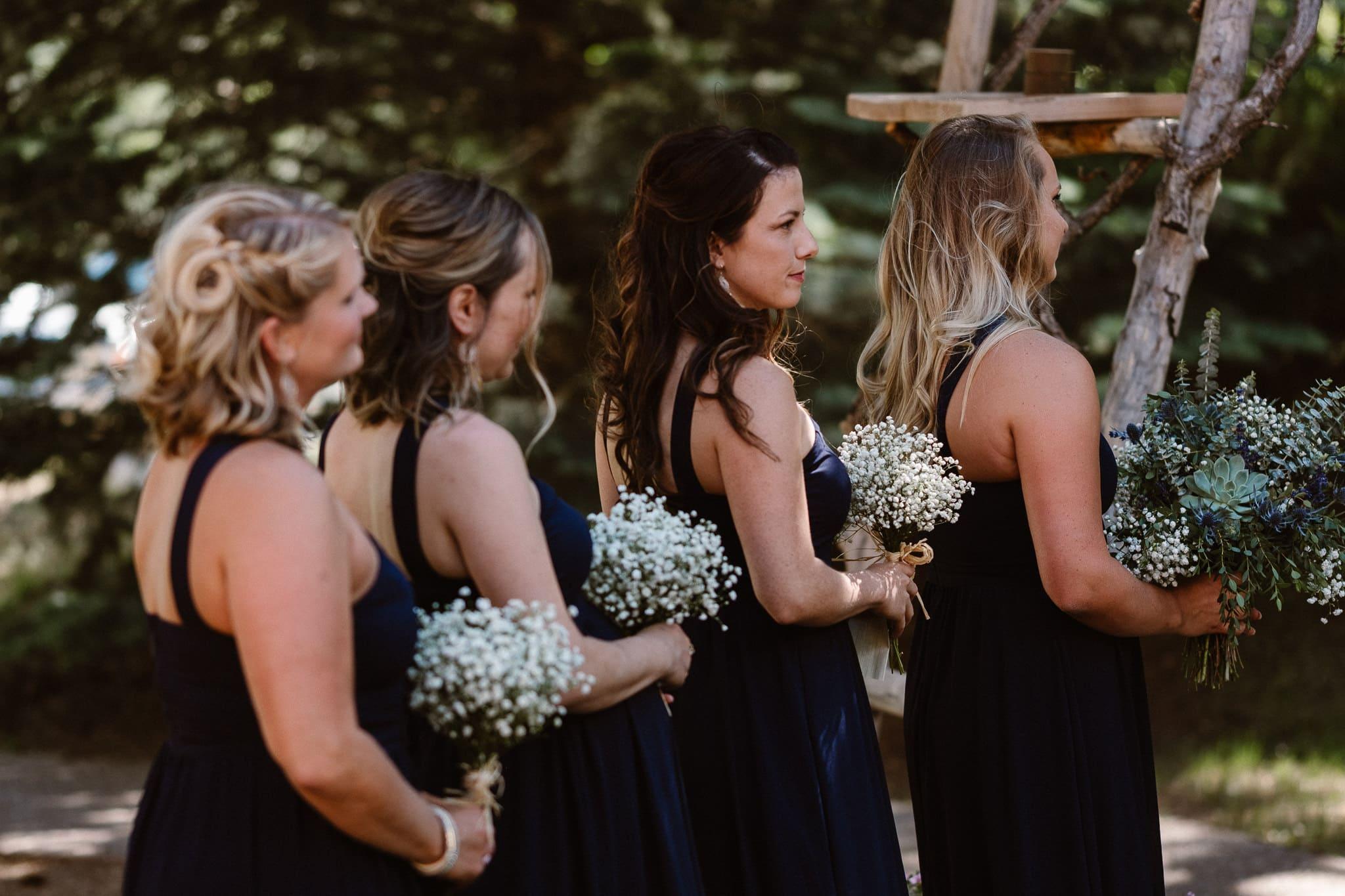 Redstone Inn wedding photographer, Carbondale wedding photographer, Colorado intimate wedding photographer, wedding ceremony, bridesmaids in dark purple dresses