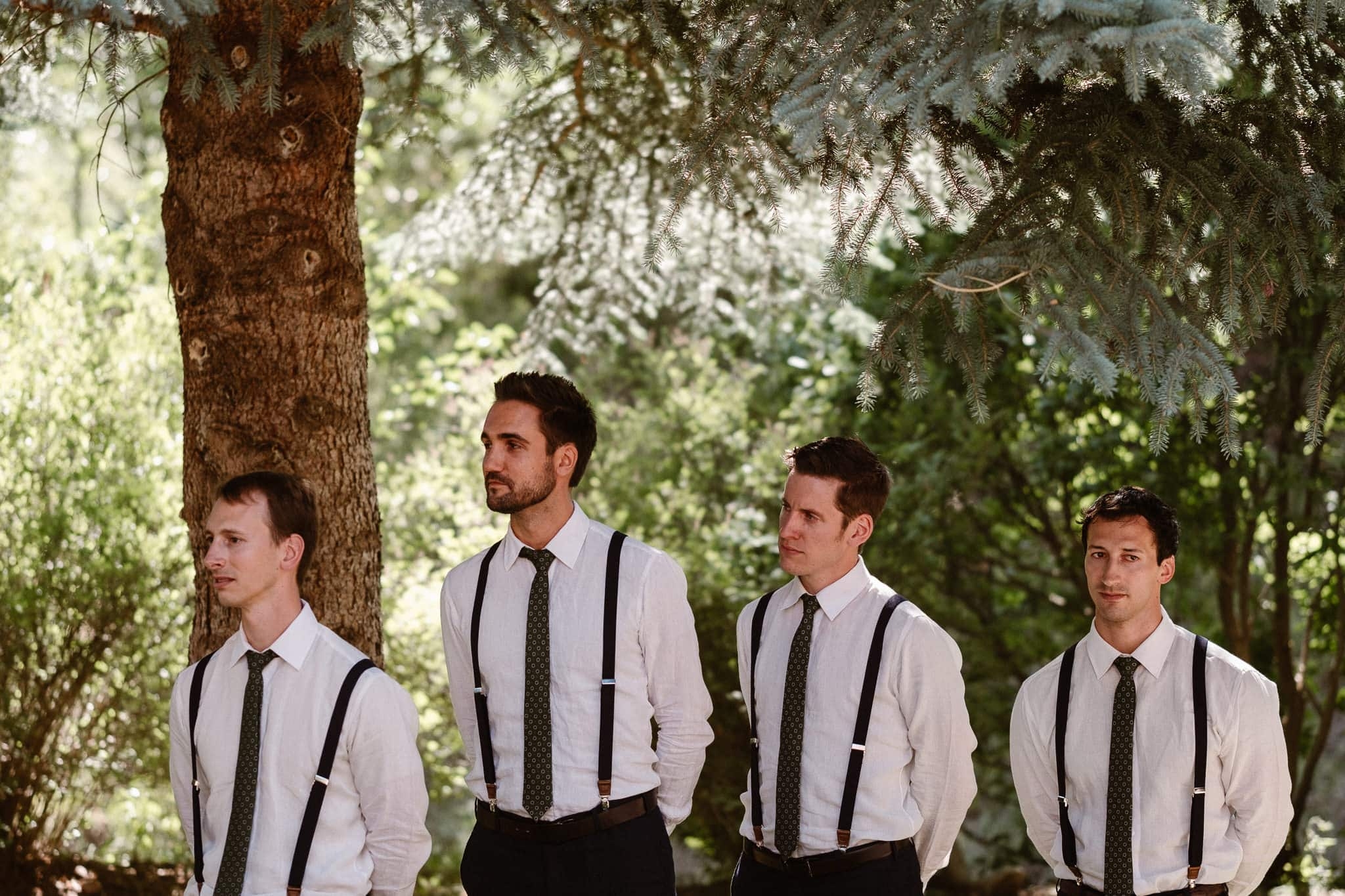 Redstone Inn wedding photographer, Carbondale wedding photographer, Colorado intimate wedding photographer, wedding ceremony, groomsmen in white shirts with black ties and suspenders