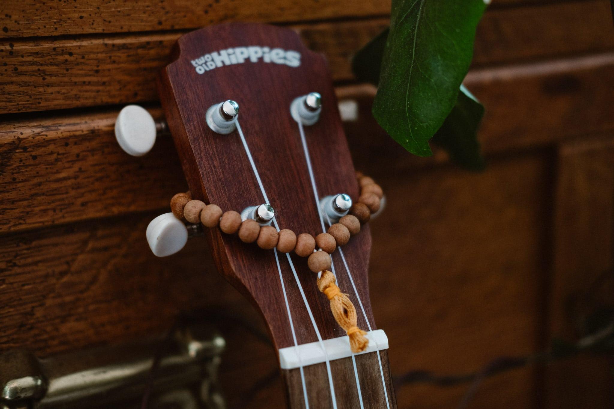 Mala beads on guitar