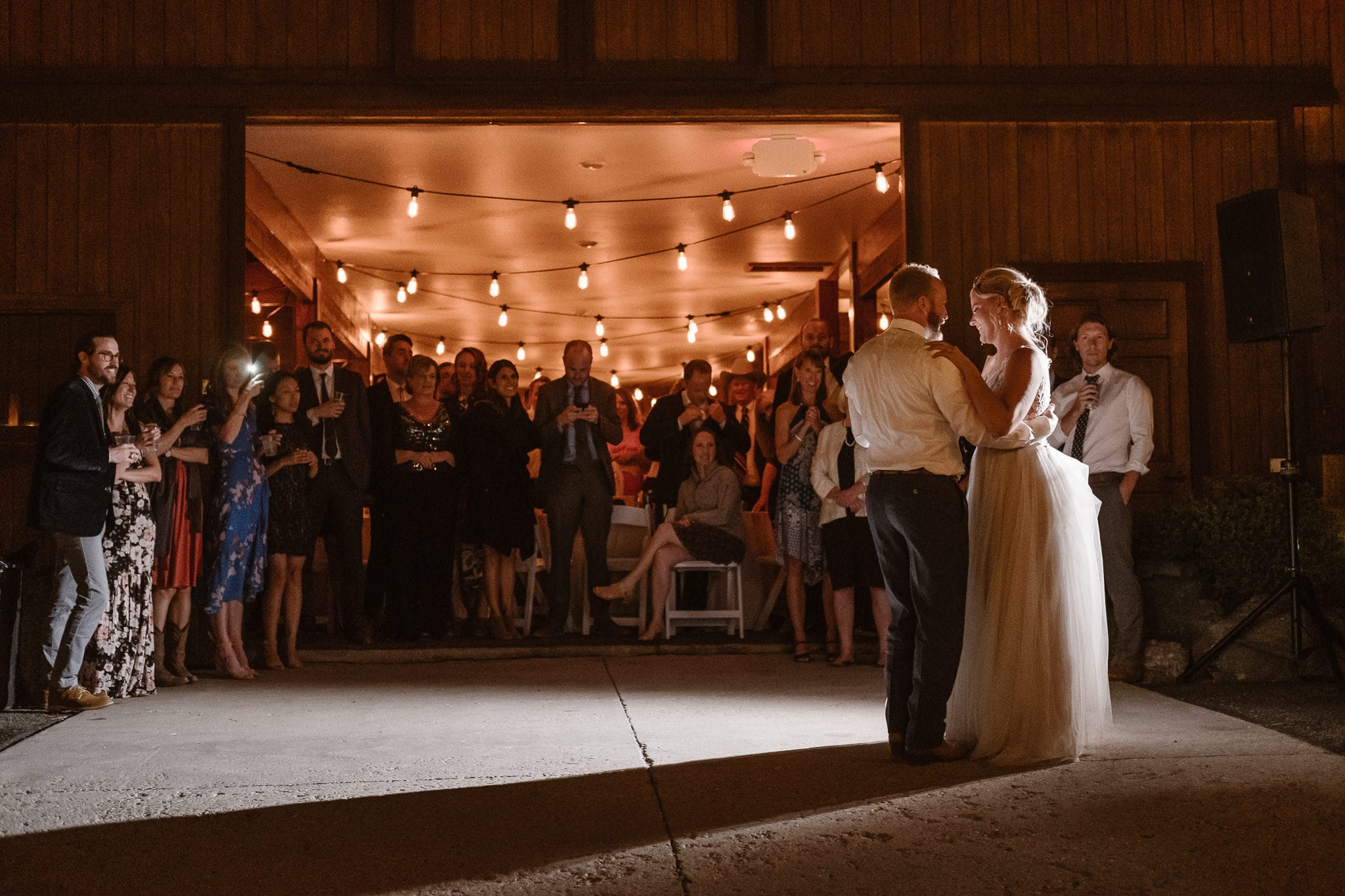 Steamboat Springs wedding photographer, La Joya Dulce wedding, Colorado ranch wedding venues, bride and groom first dance under market lights