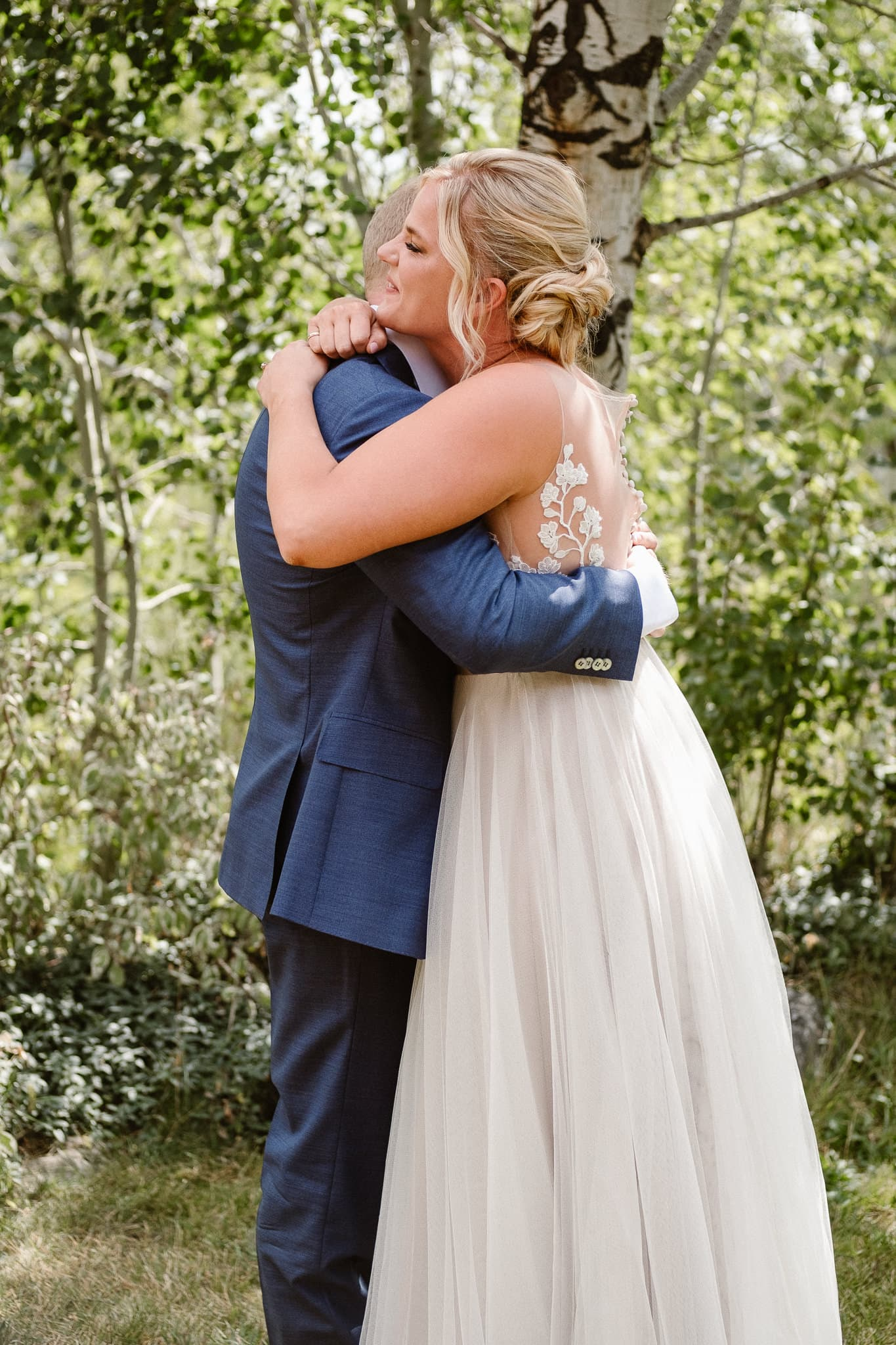 Steamboat Springs wedding photographer, La Joya Dulce wedding, Colorado ranch wedding venues, bride and groom hugging, first look,