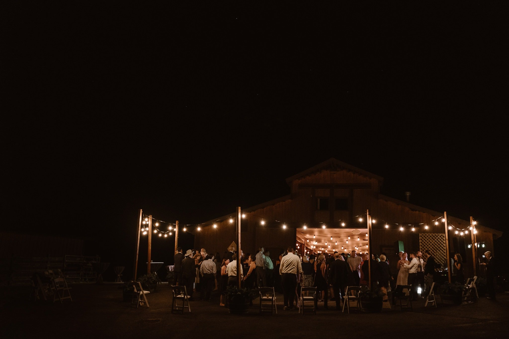 Steamboat Springs wedding photographer, La Joya Dulce wedding, wedding reception outdoor dance floor under market lights, string lights