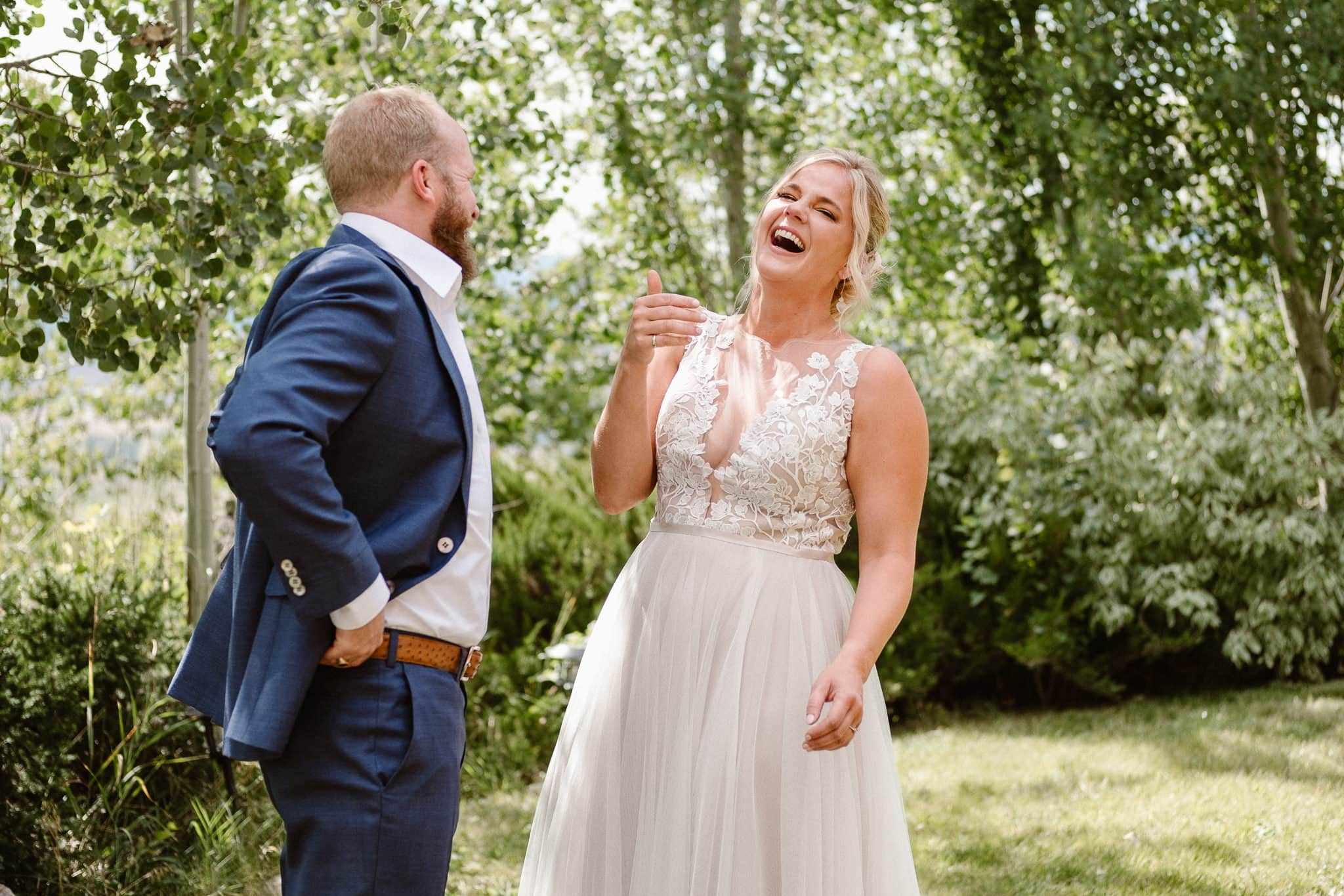 Steamboat Springs wedding photographer, La Joya Dulce wedding, Colorado ranch wedding venues, bride laughing at first look