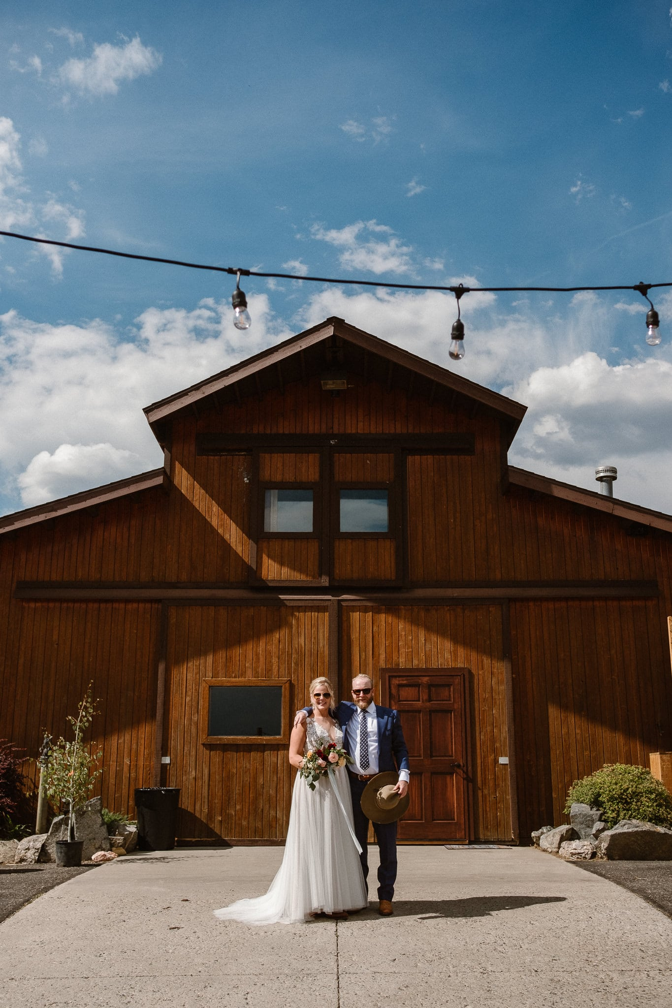 Steamboat Springs wedding photographer, La Joya Dulce wedding, Colorado ranch wedding venues, bride and groom portrait by barn wedding venue, Colorado mountain wedding venues