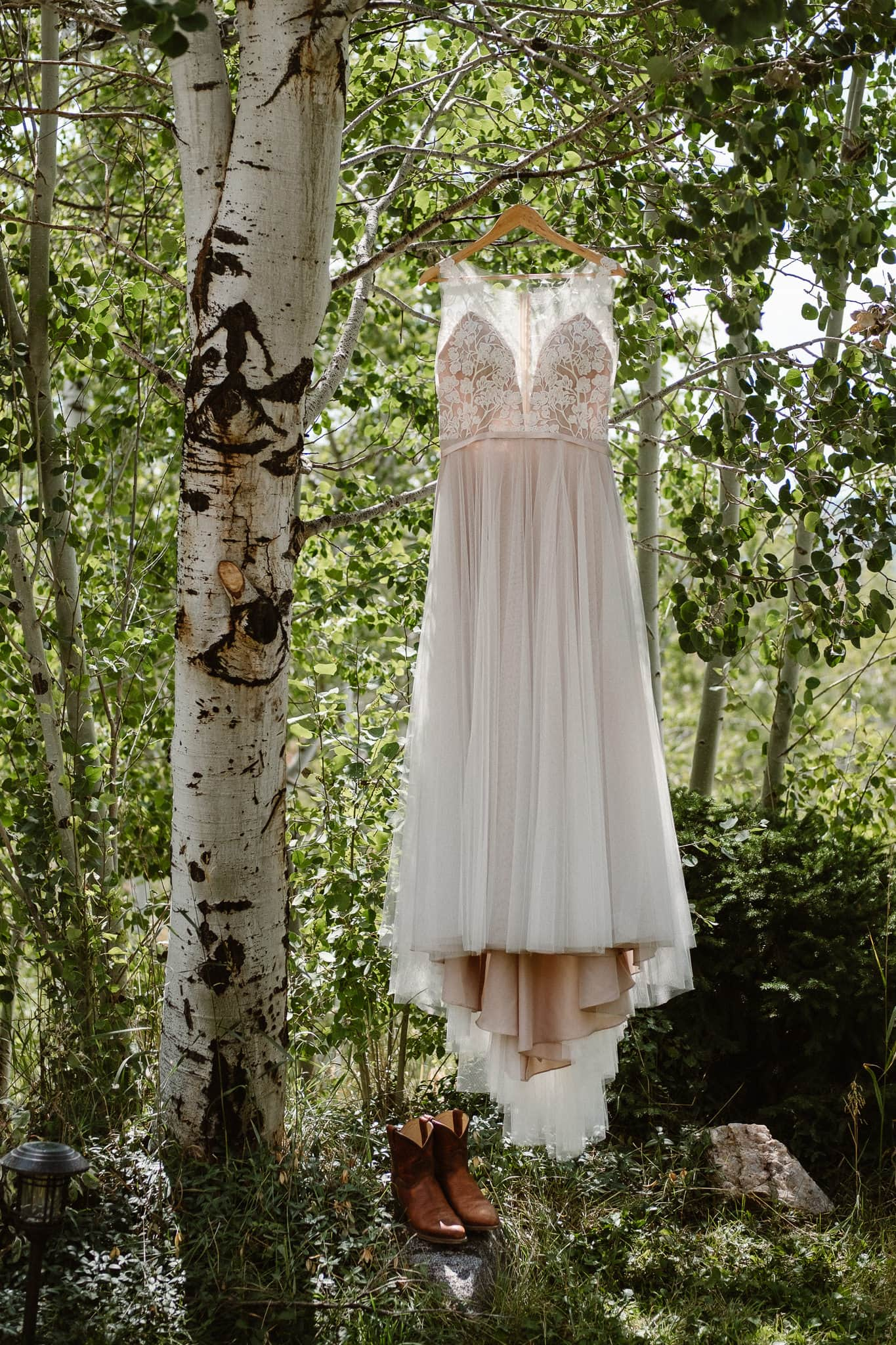 Steamboat Springs wedding photographer, La Joya Dulce wedding, Colorado ranch wedding venues, wedding dress hanging from aspen tree, wedding dress with lace top, tulle skirt wedding dress, aspen trees