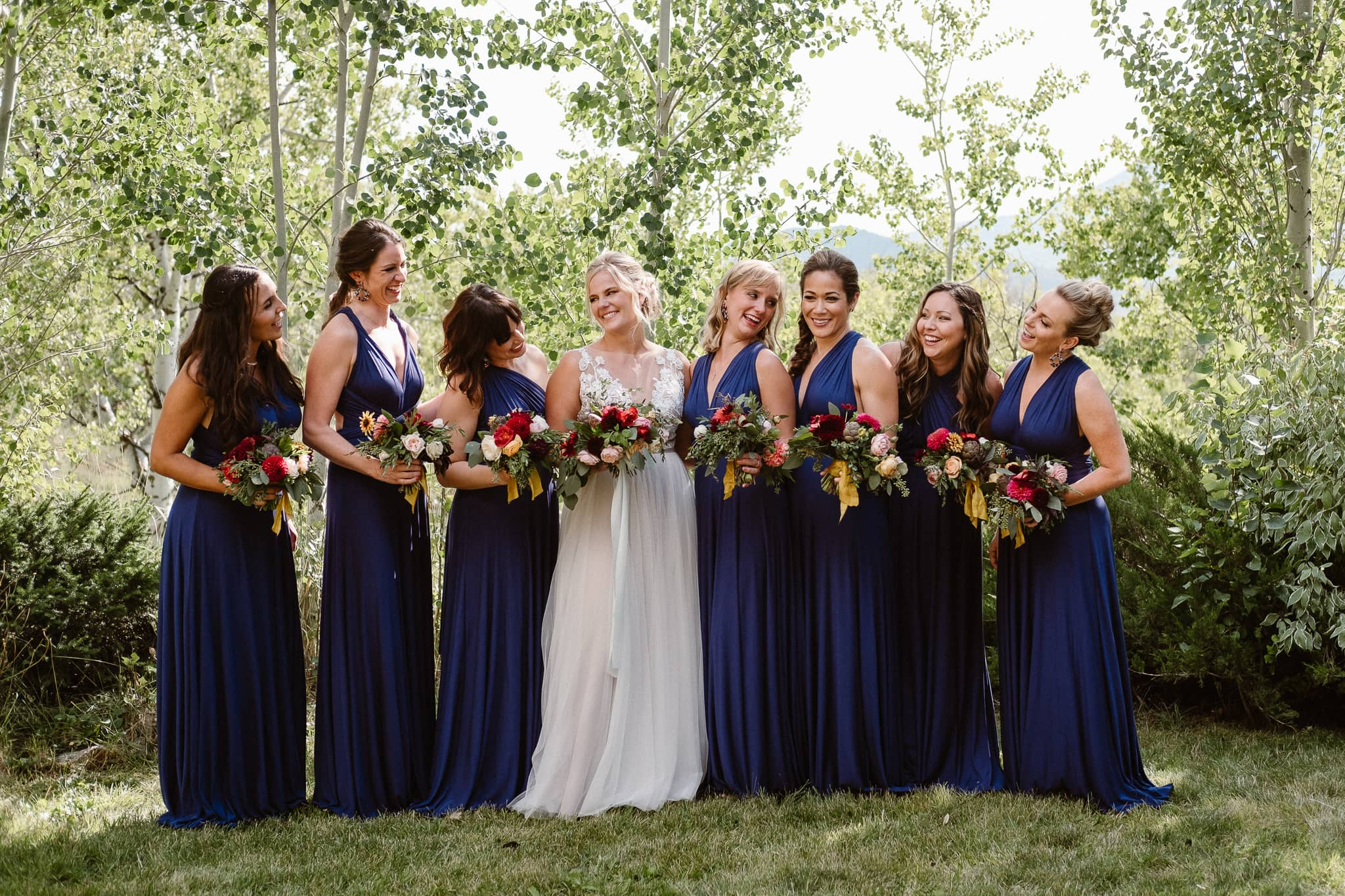 Steamboat Springs wedding photographer, La Joya Dulce wedding, Colorado ranch wedding venues, bride with wedding party, bridesmaids in navy dresses,