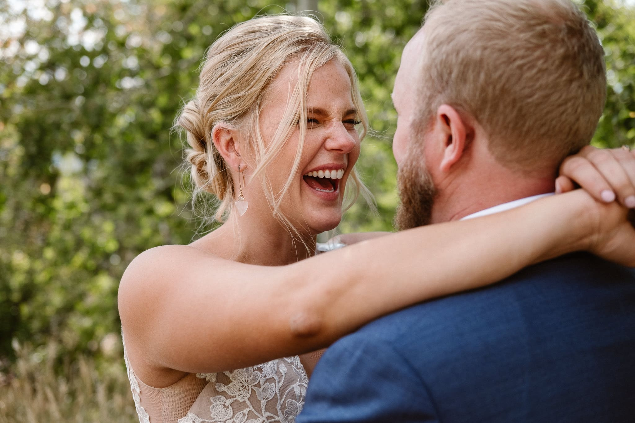 Steamboat Springs wedding photographer, La Joya Dulce wedding, Colorado ranch wedding venues, bride and groom portraits, bride laughing