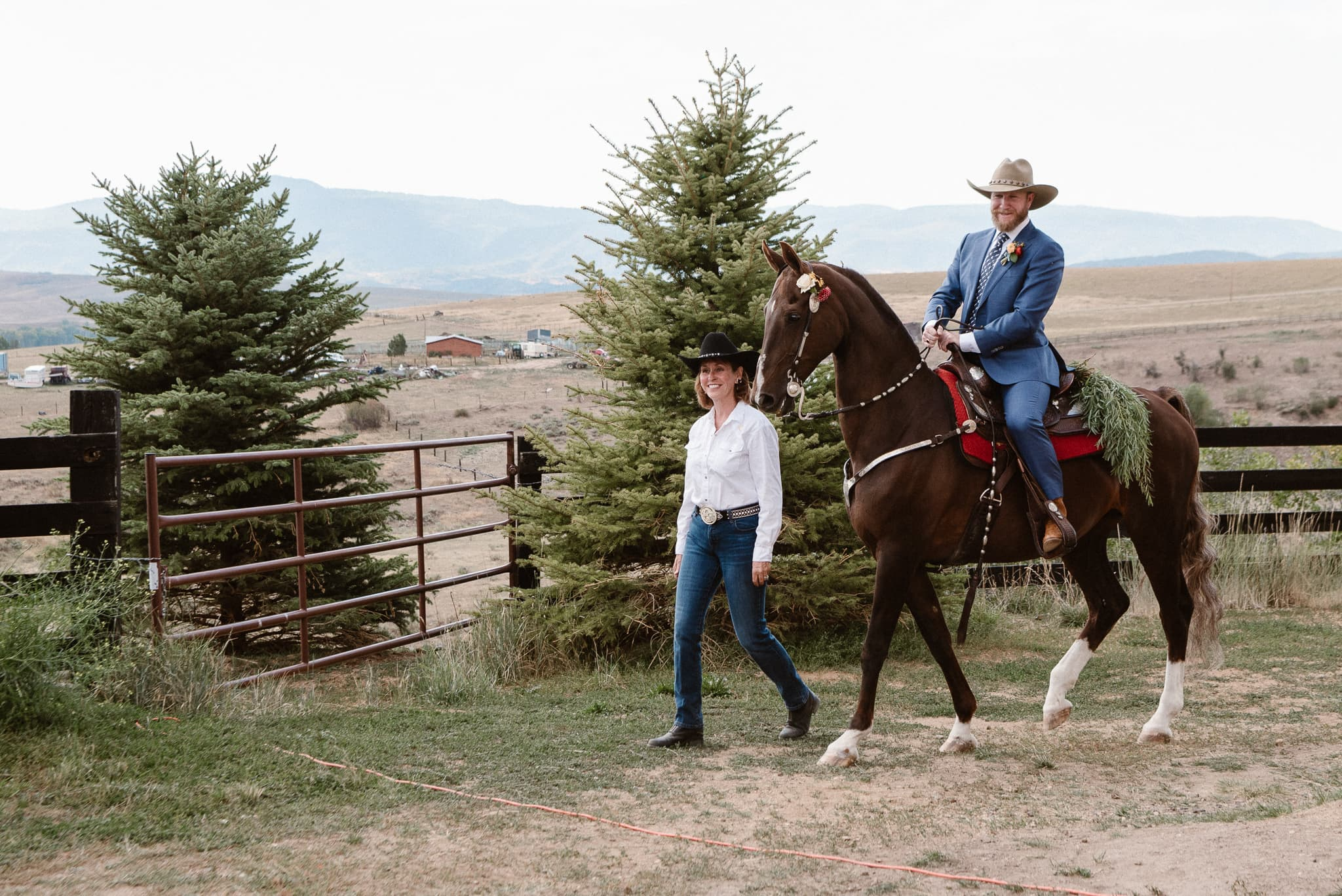 Steamboat Springs wedding photographer, La Joya Dulce wedding, Colorado ranch wedding venues, outdoor wedding ceremony, groom riding horse to ceremony