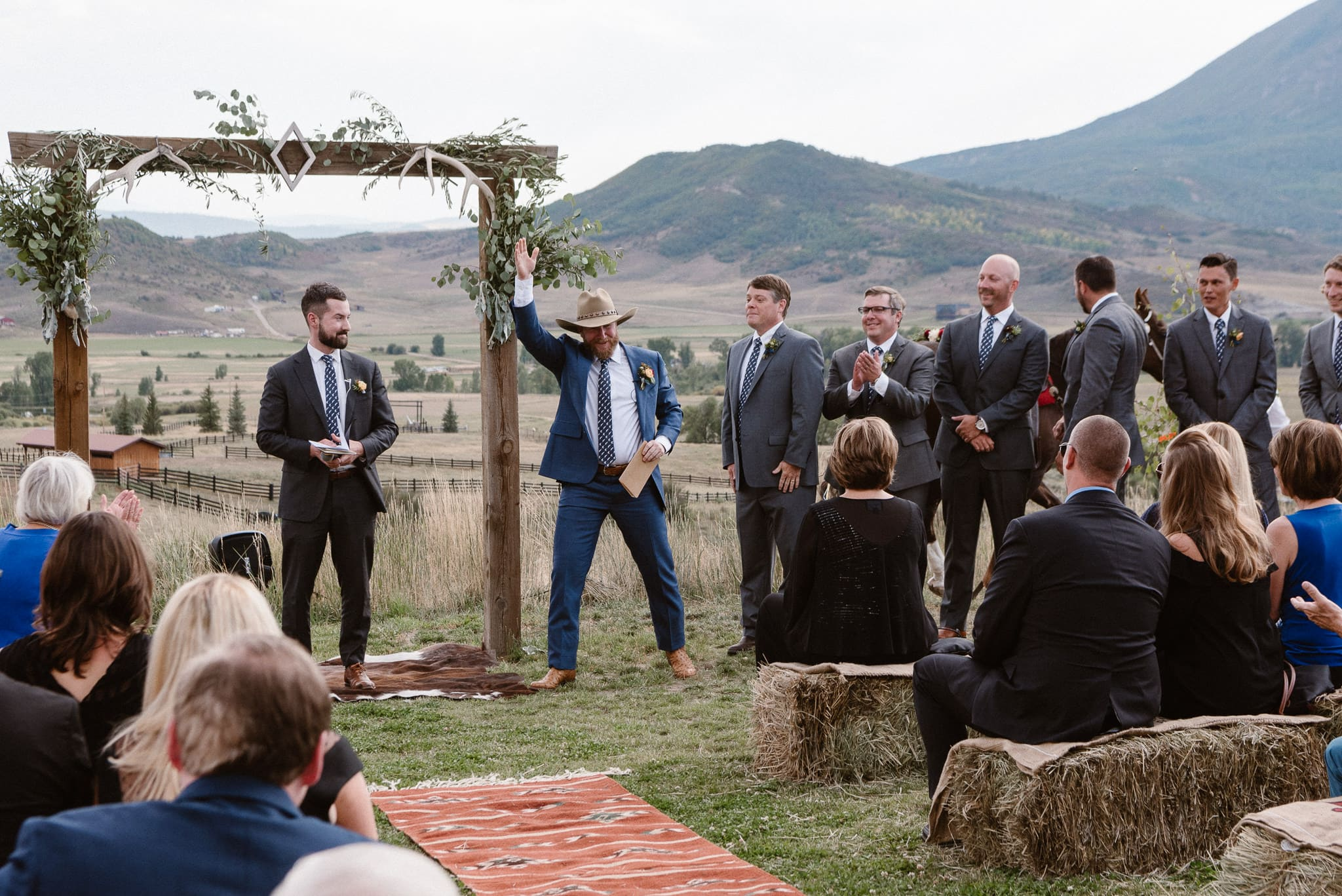 Steamboat Springs wedding photographer, La Joya Dulce wedding, Colorado ranch wedding venues, outdoor wedding ceremony, groom tipping hat to guests