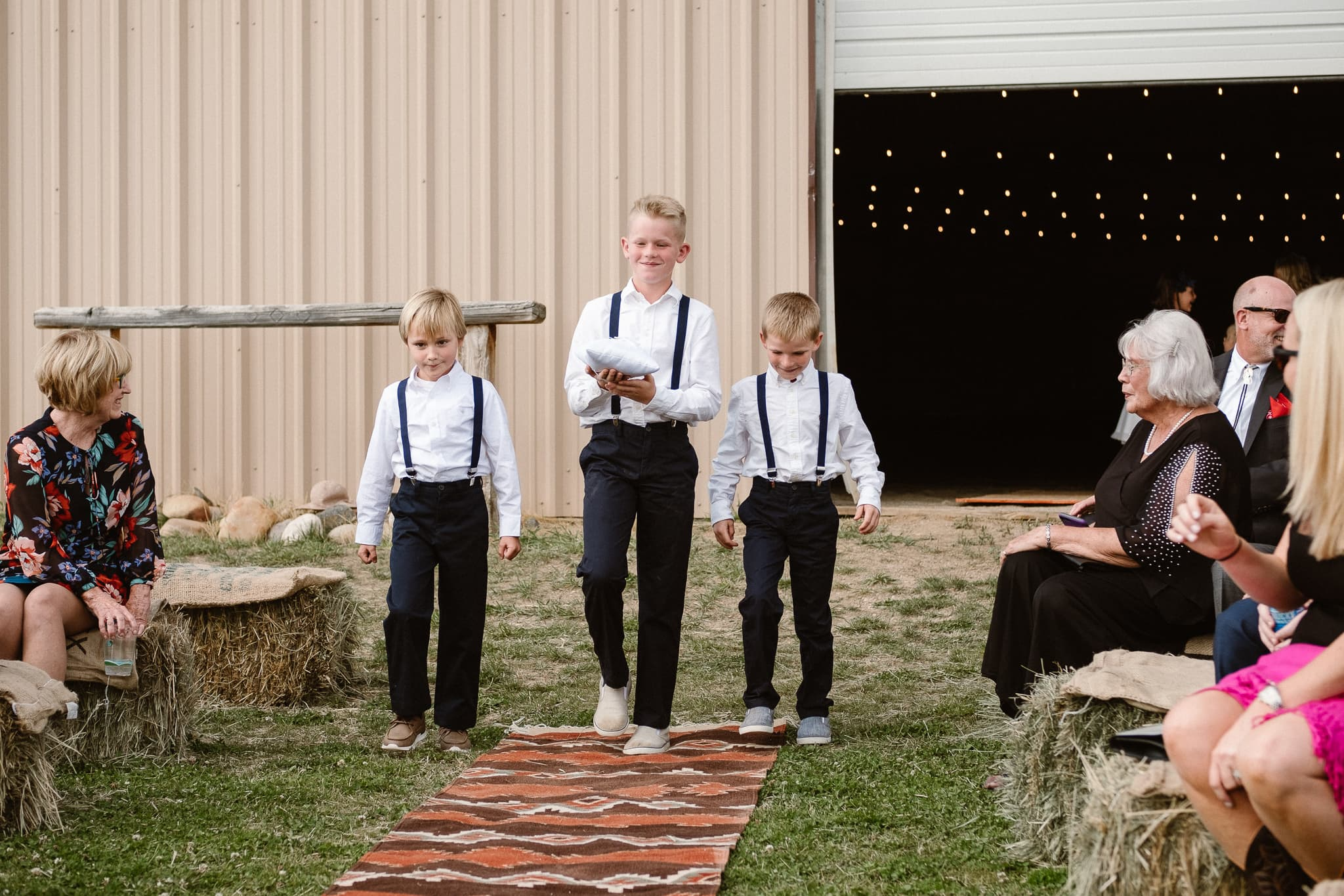 Steamboat Springs wedding photographer, La Joya Dulce wedding, Colorado ranch wedding venues, outdoor wedding ceremony, ring bearers walking up aisle
