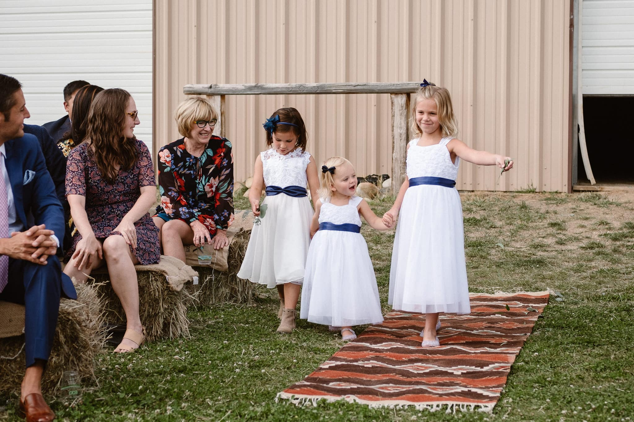 Steamboat Springs wedding photographer, La Joya Dulce wedding, Colorado ranch wedding venues, outdoor wedding ceremony, flower girls walking up aisle