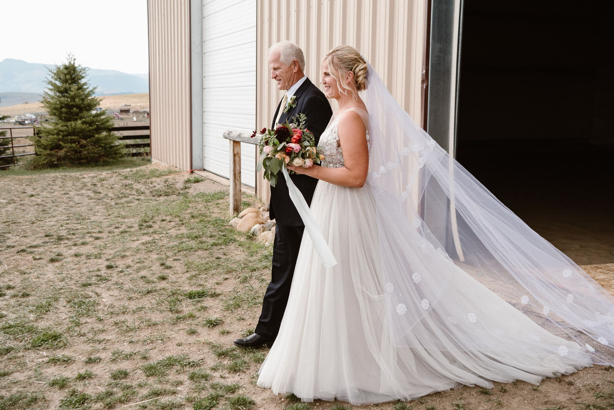 Steamboat Springs wedding photographer, La Joya Dulce wedding, Colorado ranch wedding venues, outdoor wedding ceremony, bride and her dad walking up the aisle