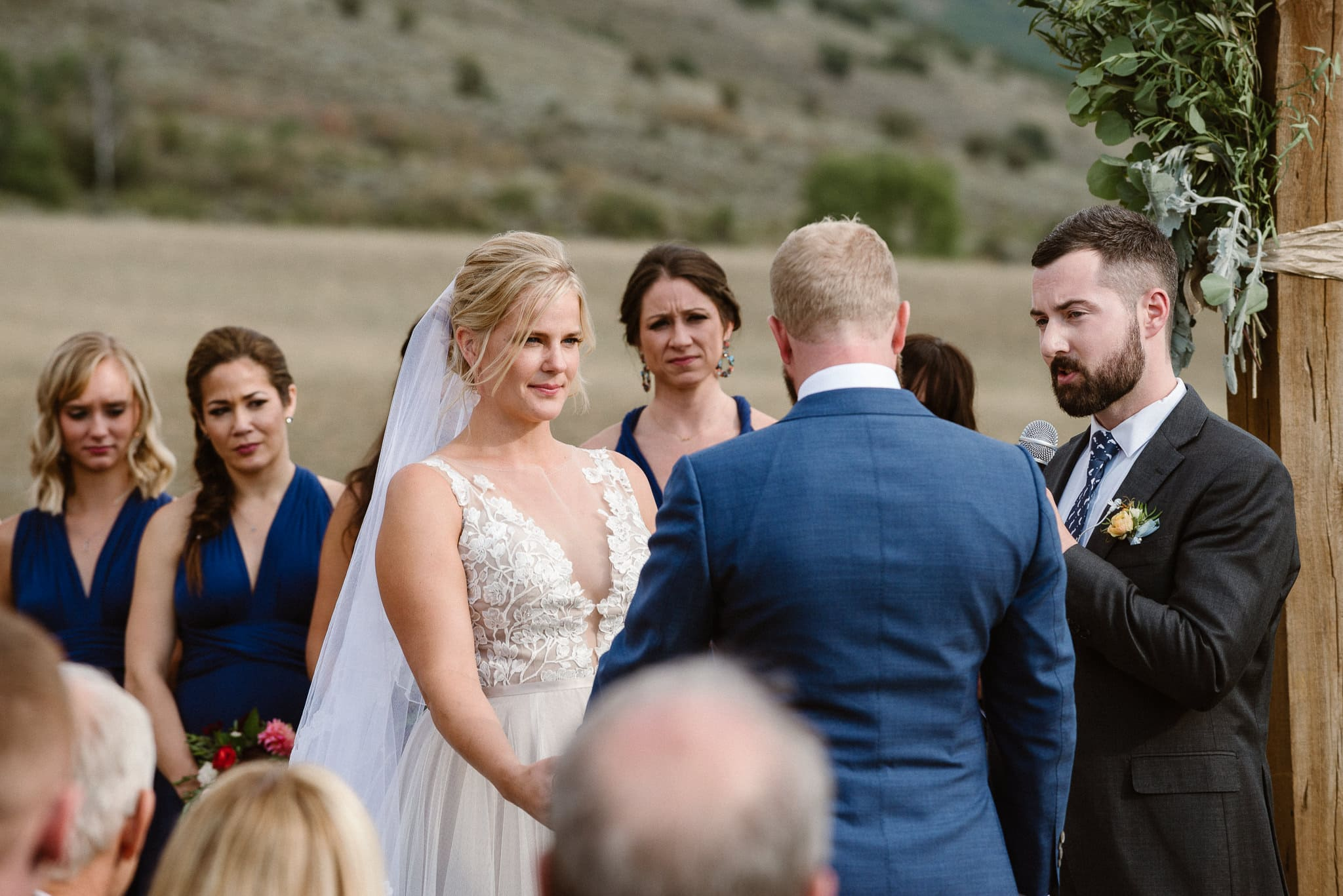 Steamboat Springs wedding photographer, La Joya Dulce wedding, Colorado ranch wedding venues, outdoor wedding ceremony, bridesmaids watching wedding ceremony, bride during ceremony