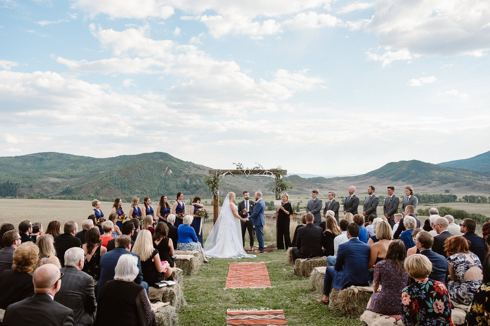 Steamboat Springs wedding photographer, La Joya Dulce wedding, Colorado ranch wedding venues, outdoor wedding ceremony, bridesmaids watching wedding ceremony, Colorado wedding, Rocky Mountain wedding, ranch wedding