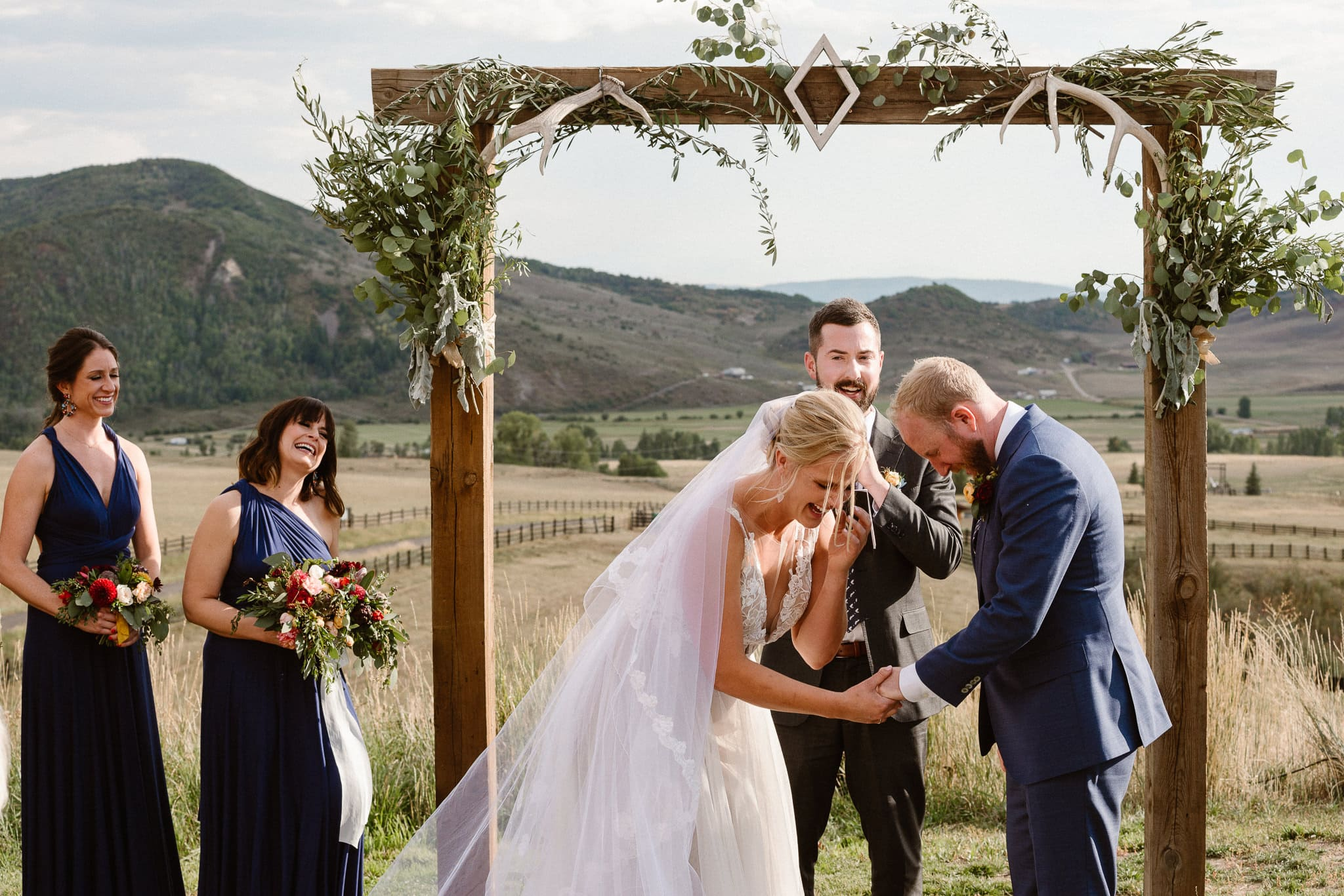 Steamboat Springs wedding photographer, La Joya Dulce wedding, Colorado ranch wedding venues, outdoor wedding ceremony, Colorado wedding, Rocky Mountain wedding, ranch wedding, bride laughing