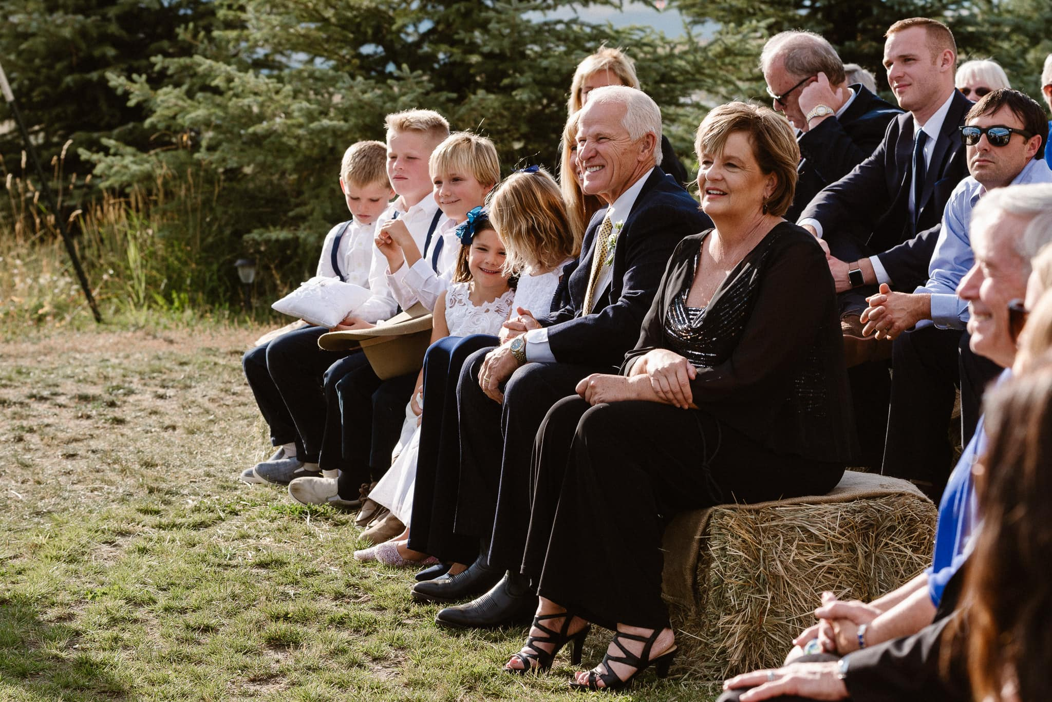 Steamboat Springs wedding photographer, La Joya Dulce wedding, Colorado ranch wedding venues, outdoor wedding ceremony, Colorado wedding, Rocky Mountain wedding, ranch wedding, guests watching ceremony, parents watching wedding ceremony