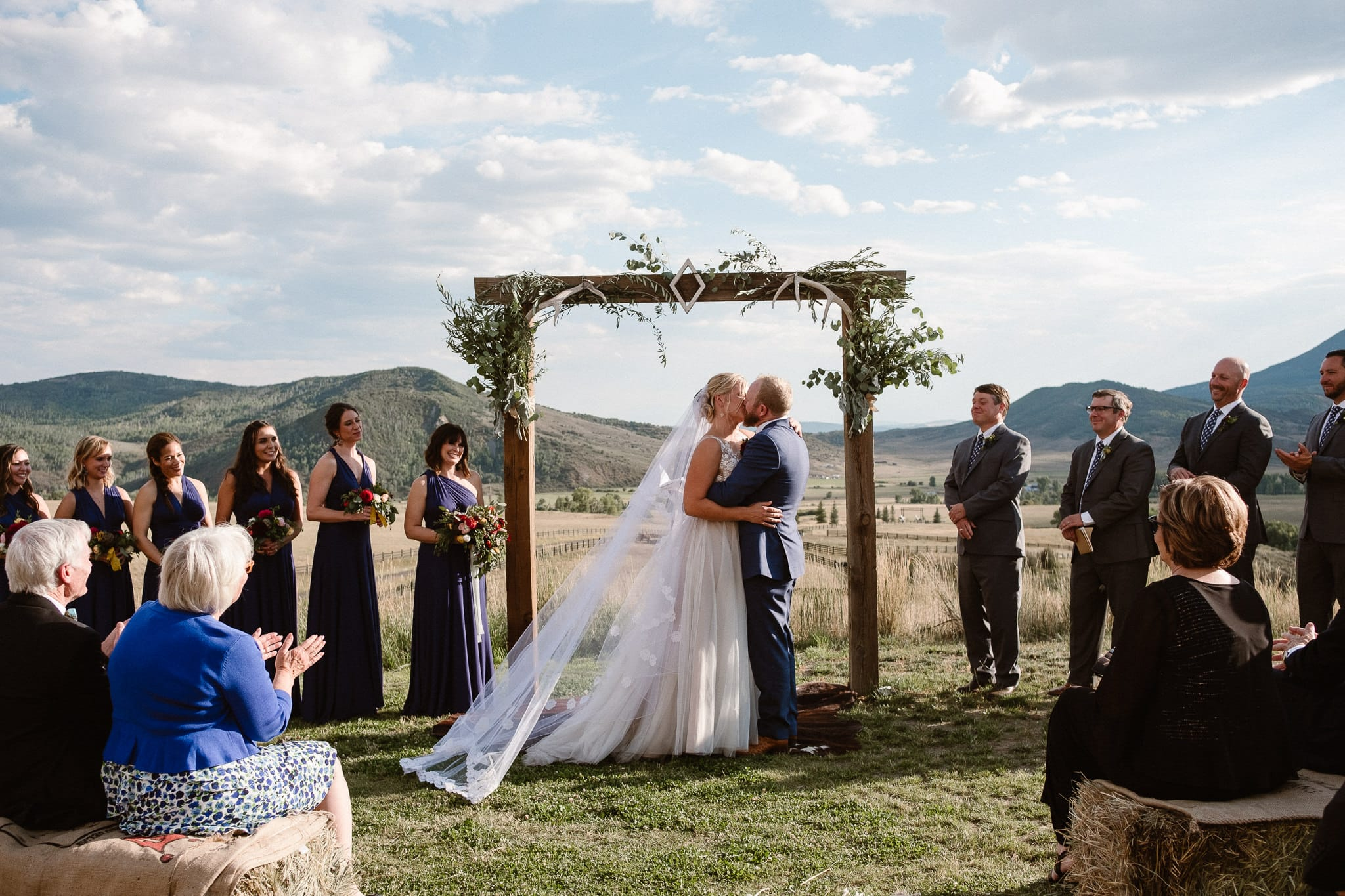 Steamboat Springs wedding photographer, La Joya Dulce wedding, Colorado ranch wedding venues, outdoor wedding ceremony, Colorado wedding, Rocky Mountain wedding, ranch wedding, first kiss