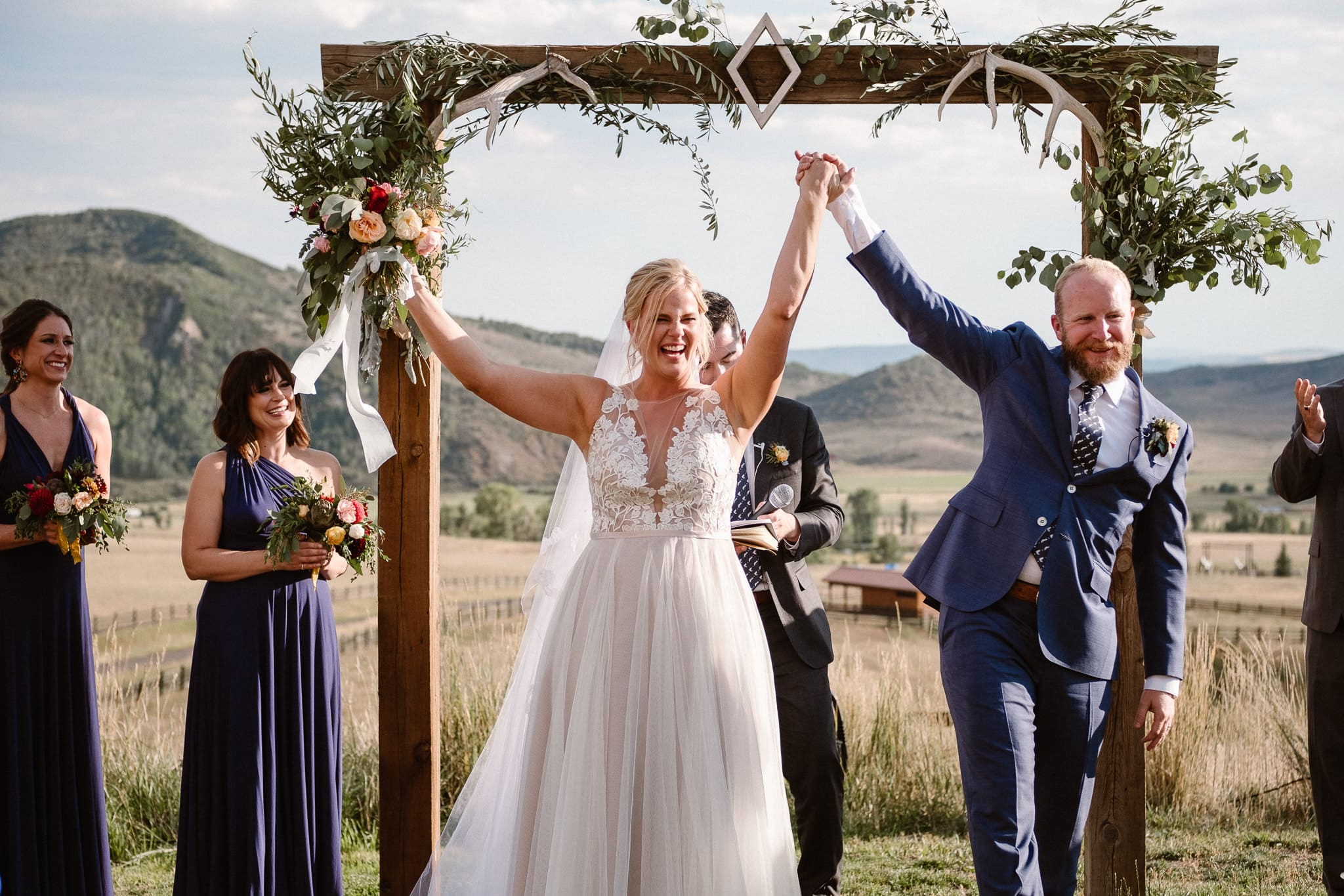 Steamboat Springs wedding photographer, La Joya Dulce wedding, Colorado ranch wedding venues, outdoor wedding ceremony, Colorado wedding, Rocky Mountain wedding, ranch wedding, bride and groom celebrating, wedding recessional