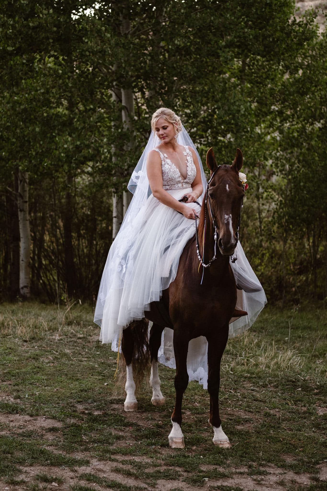 Steamboat Springs wedding photographer, La Joya Dulce wedding, Colorado ranch wedding venues, outdoor wedding ceremony, Colorado wedding, Rocky Mountain wedding, ranch wedding, bride riding horse