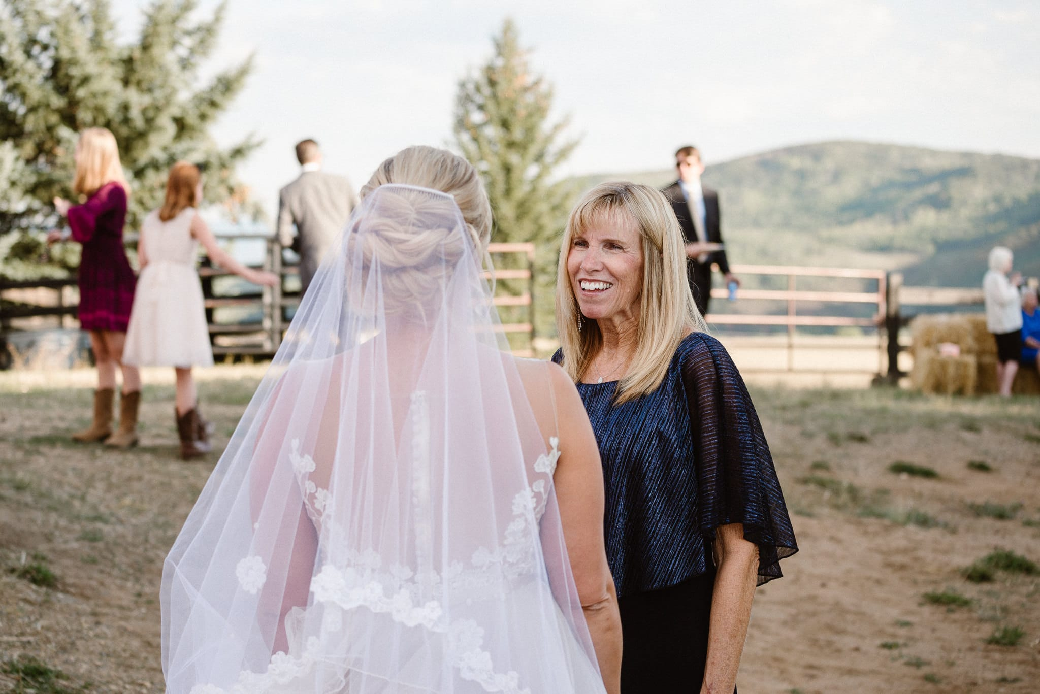 Steamboat Springs wedding photographer, La Joya Dulce wedding, Colorado ranch wedding venues, bride talking to her mom