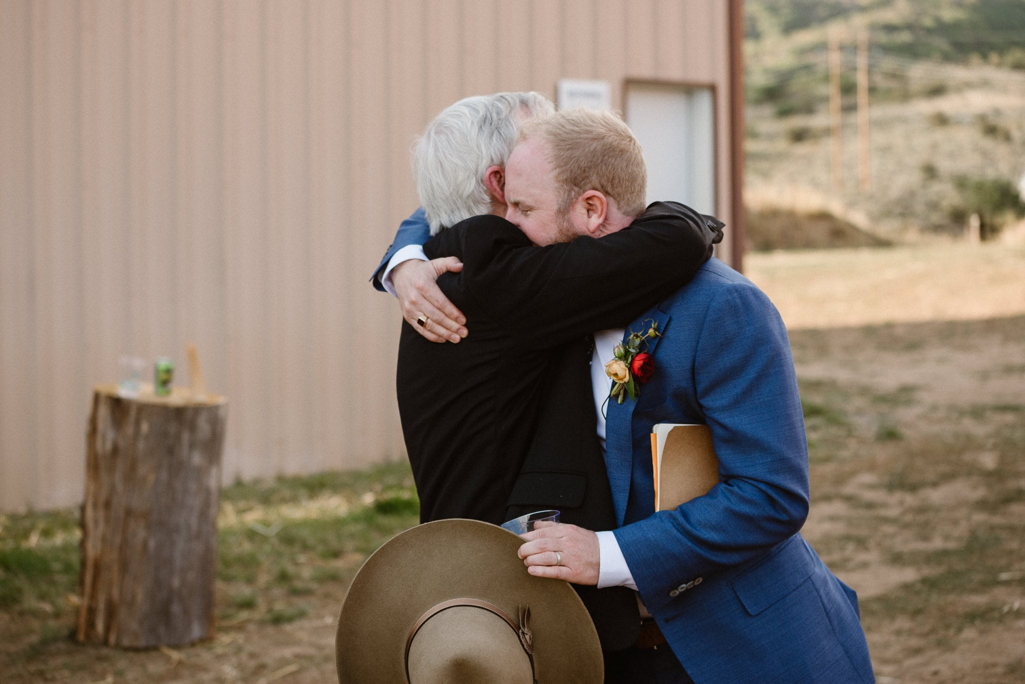 Steamboat Springs wedding photographer, La Joya Dulce wedding, Colorado ranch wedding venues, groom hugging his dad