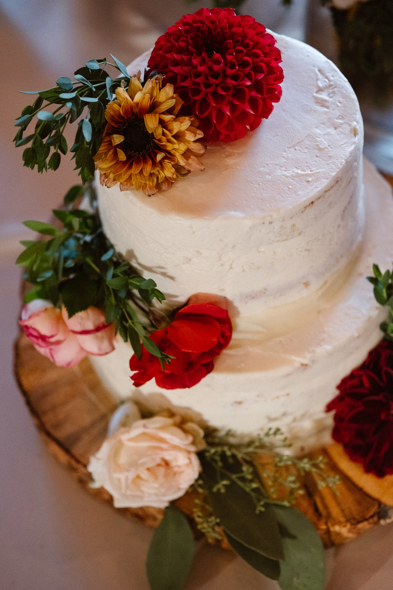 Steamboat Springs wedding photographer, La Joya Dulce wedding, Colorado ranch wedding venues, white wedding cake with flowers