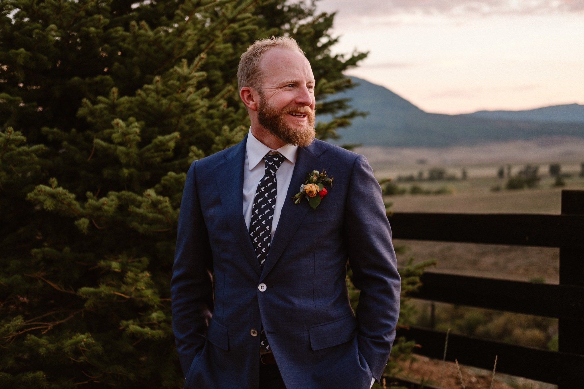 Steamboat Springs wedding photographer, La Joya Dulce wedding, Colorado ranch wedding venues, groom portrait, groom in dark blue dress, groom with fish tie