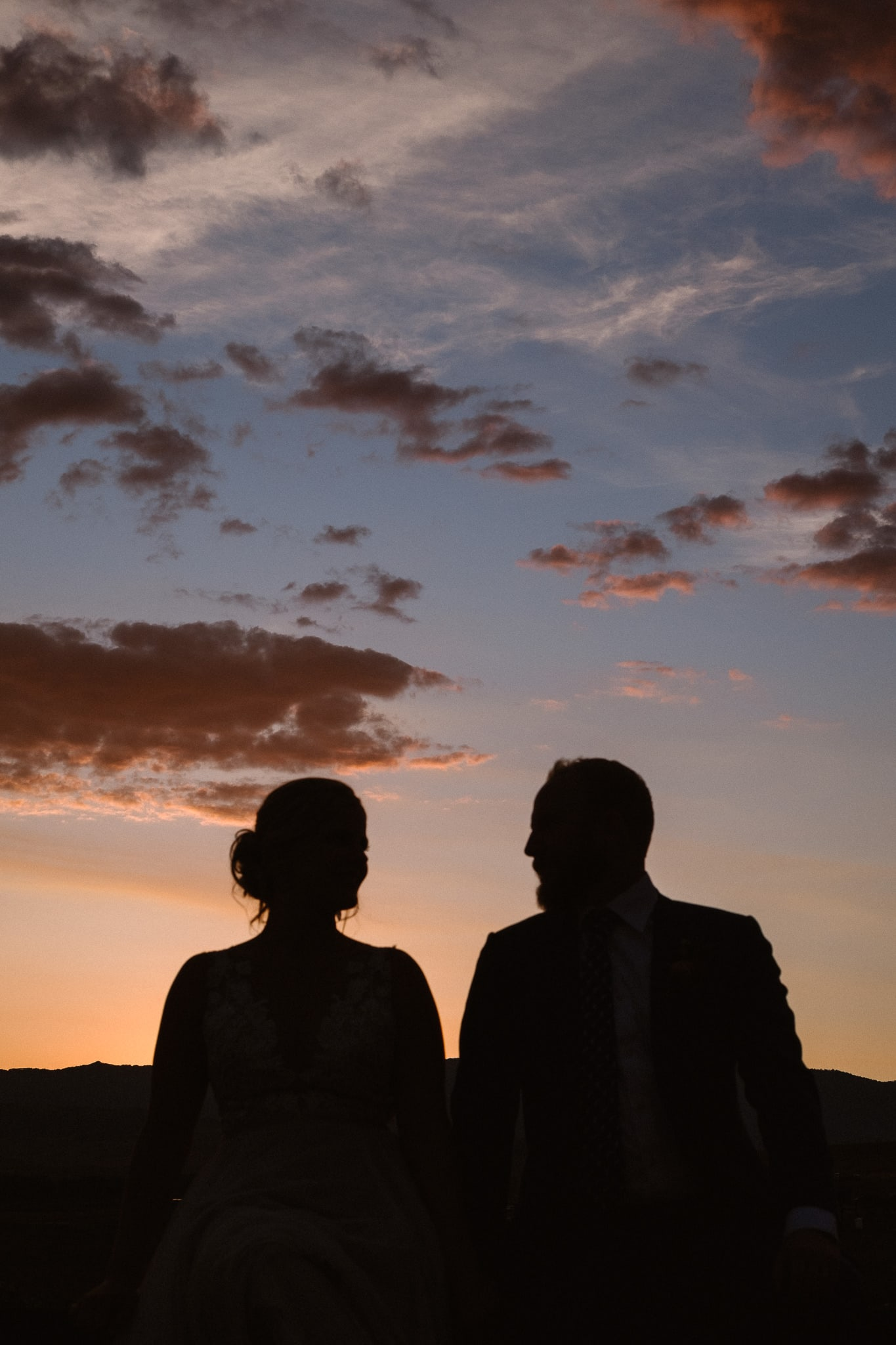 Steamboat Springs wedding photographer, La Joya Dulce wedding, Colorado ranch wedding venues, bride and groom portraits at sunset, bride and groom silhouettes at sunset
