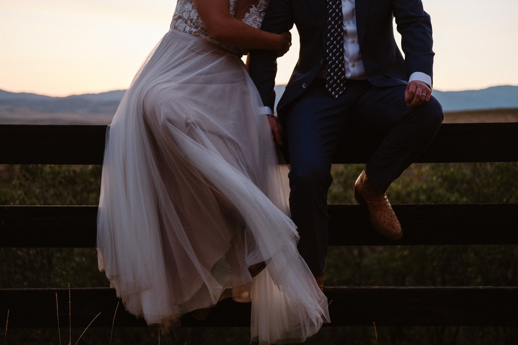Steamboat Springs wedding photographer, La Joya Dulce wedding, Colorado ranch wedding venues, bride and groom portraits at sunset, bride and groom sitting on fence, bride and groom portraits