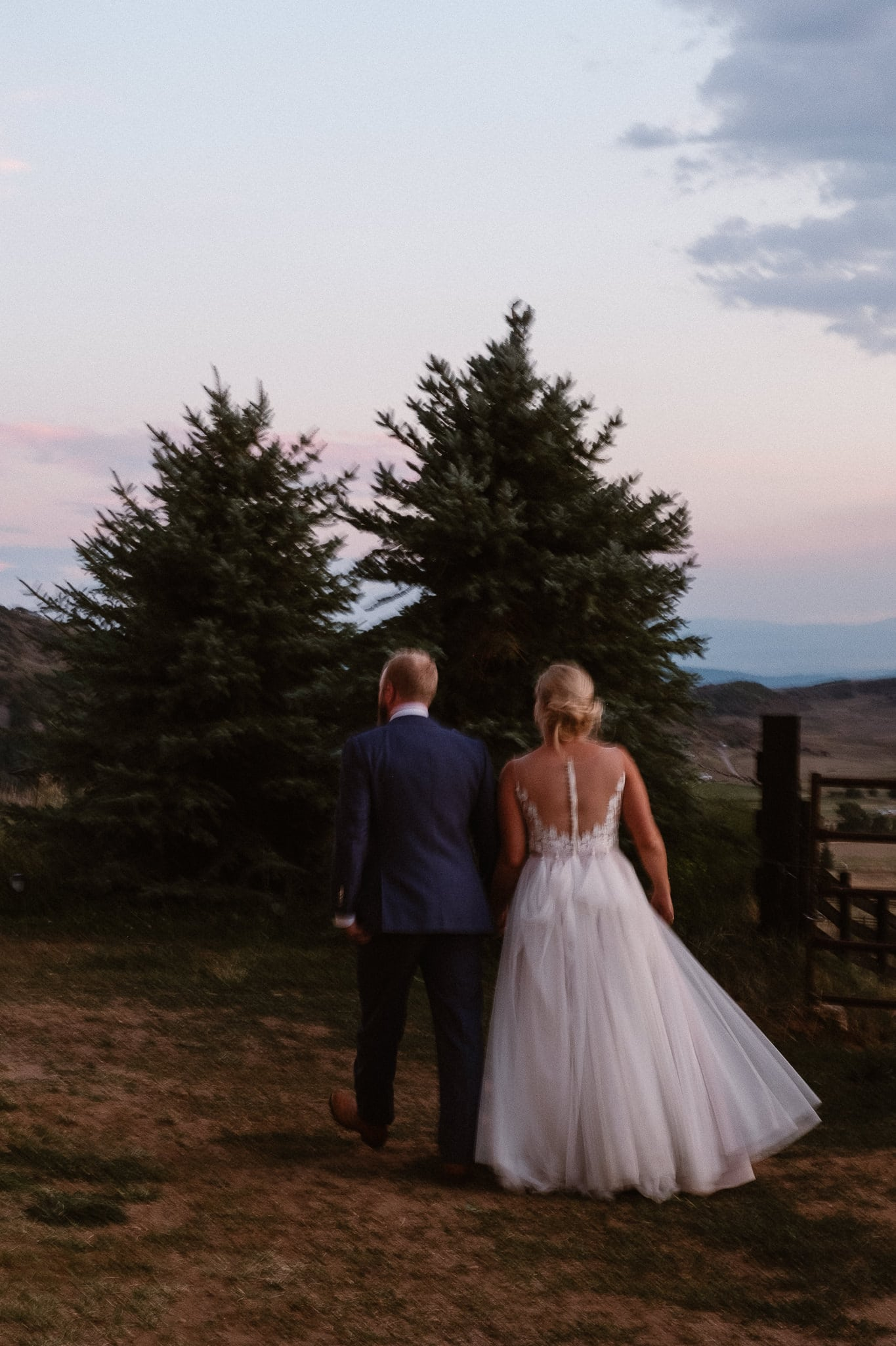 Steamboat Springs wedding photographer, La Joya Dulce wedding, Colorado ranch wedding venues, bride and groom walking at sunset
