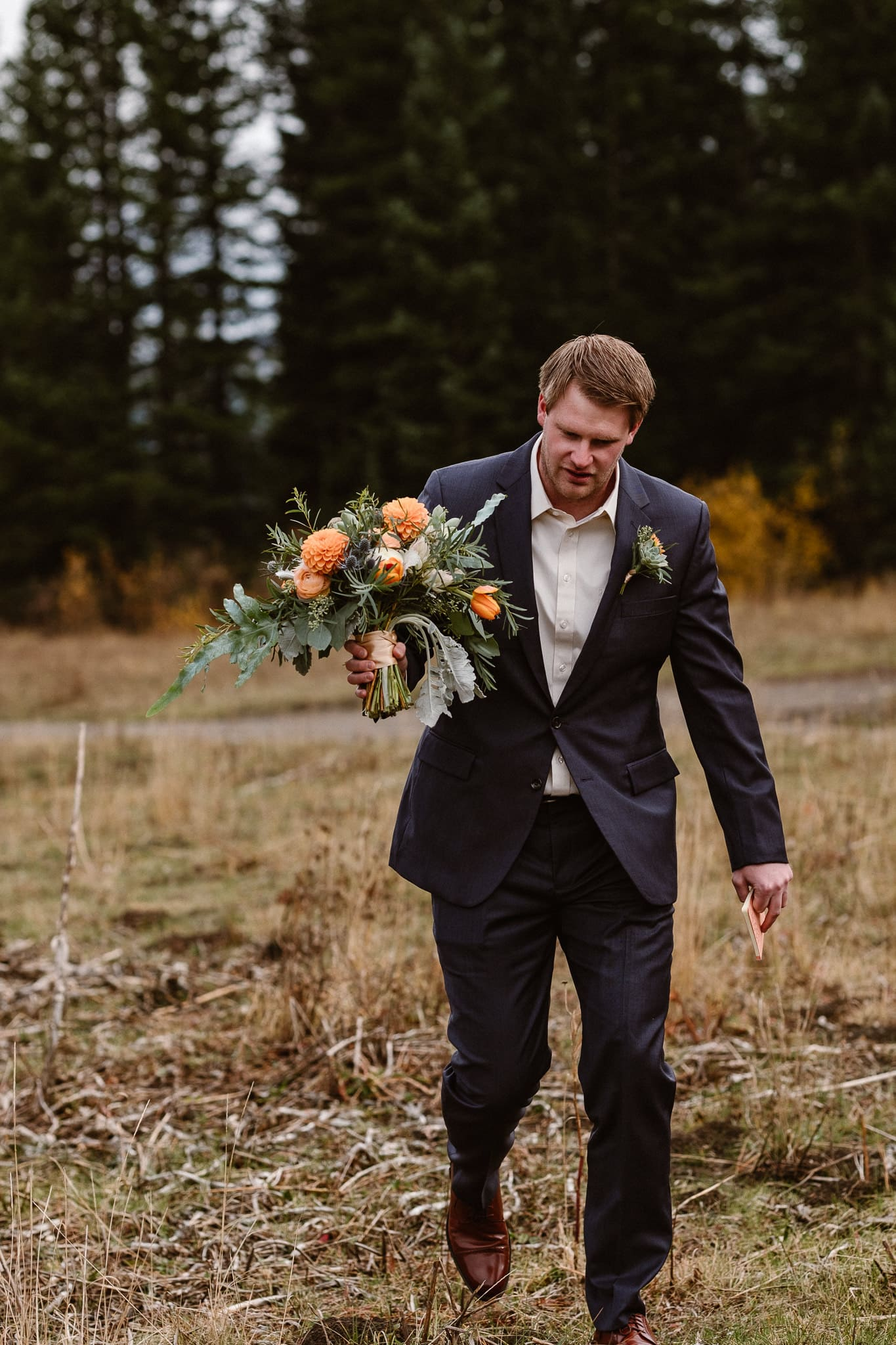 Crested Butte Wedding Photographer, Scarp Ridge Lodge intimate elopement, self solemnized elopement in Colorado, bride and groom portraits, Colorado mountain adventure wedding, groom carrying bouquet