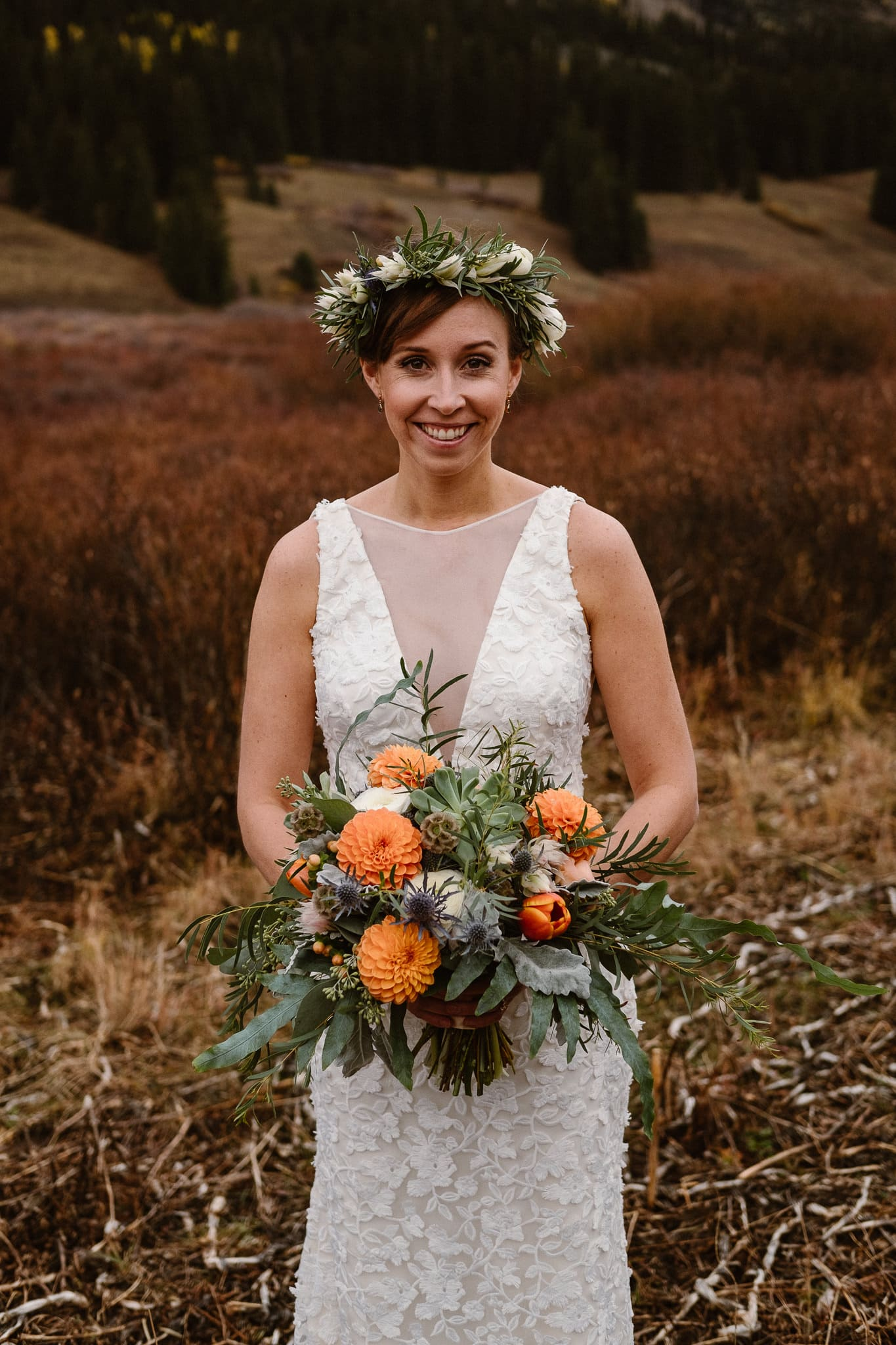 Crested Butte Wedding Photographer, Scarp Ridge Lodge intimate elopement, self solemnized elopement in Colorado, bride and groom portraits, Colorado mountain adventure wedding, bride wearing floral crown, fall color bouquet with orange flowers by From the Ground Up, wedding bouquet