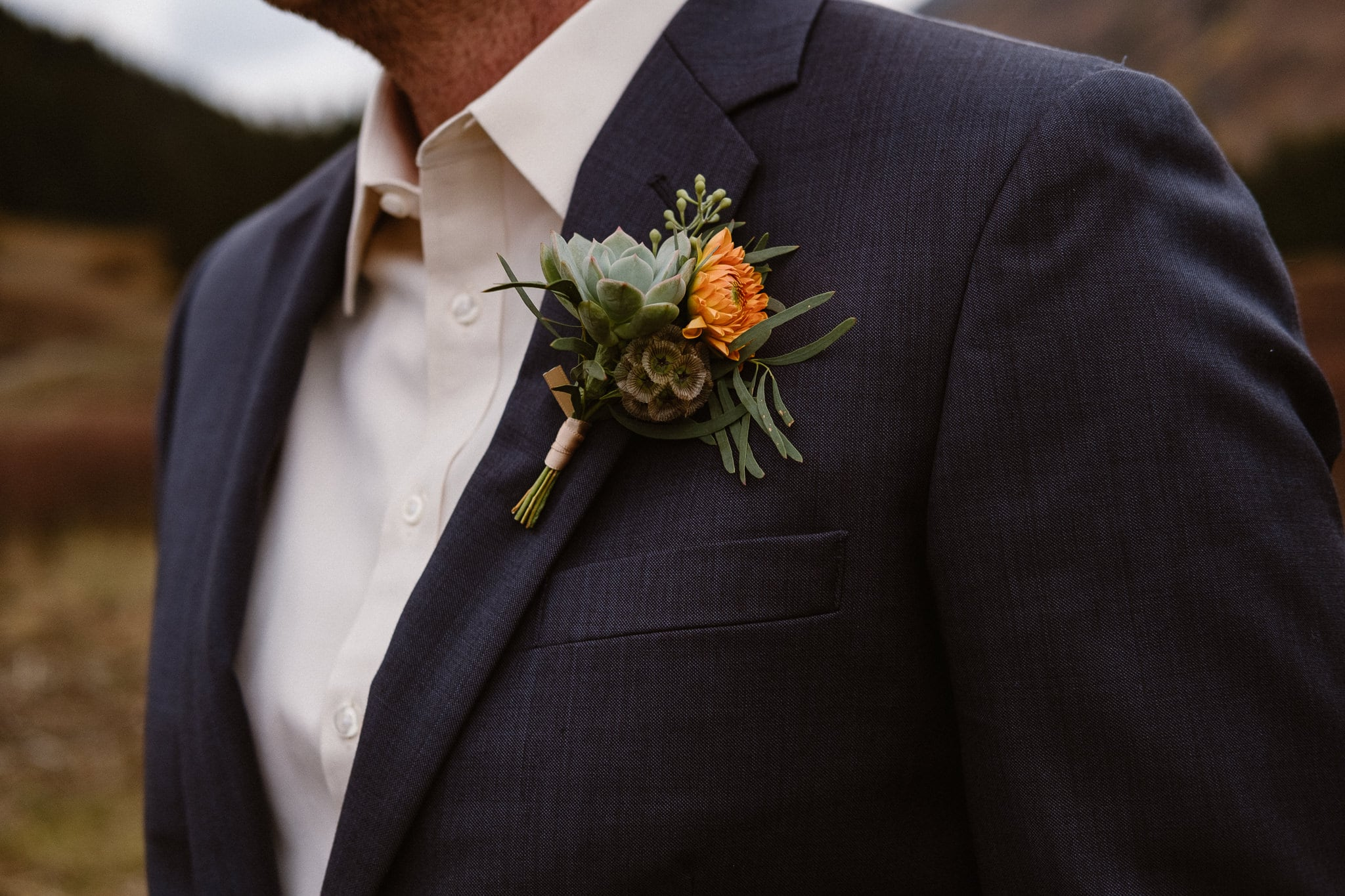 Crested Butte Wedding Photographer, Scarp Ridge Lodge intimate elopement, self solemnized elopement in Colorado, bride and groom portraits, Colorado mountain adventure wedding, groom with orange and green boutonniere by From the Ground Up Flowers
