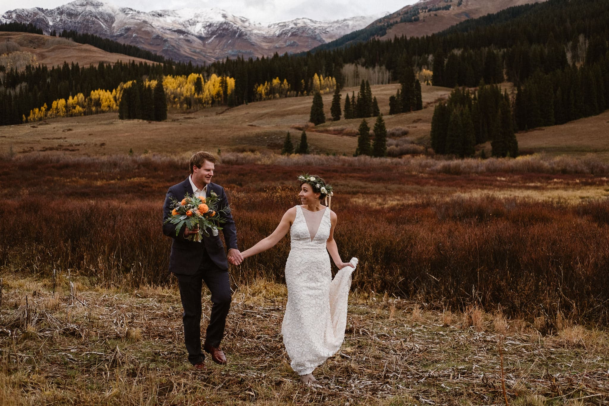Crested Butte Wedding Photographer, Scarp Ridge Lodge intimate elopement photographer, bride and groom walking