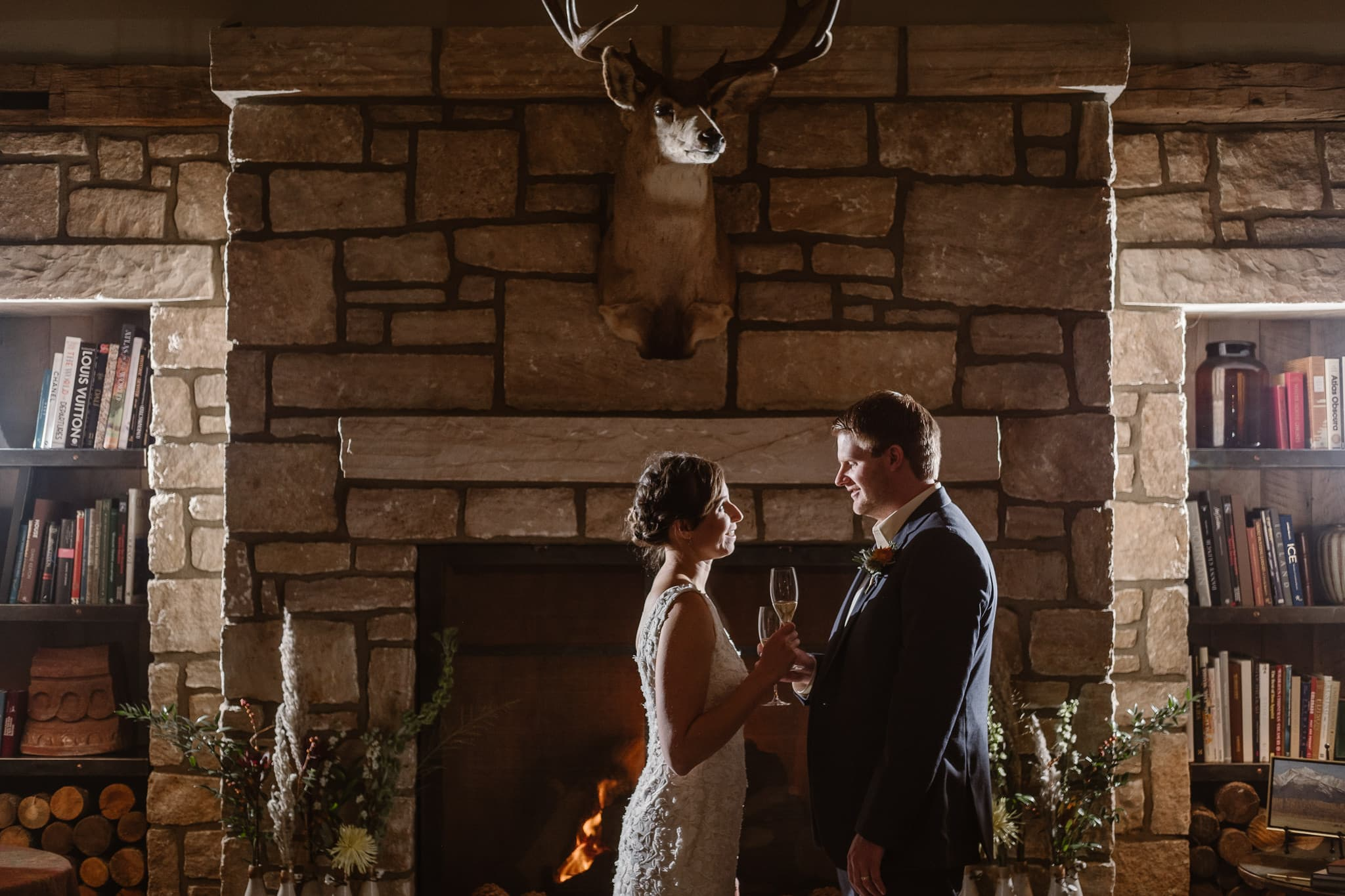 Crested Butte Wedding Photographer, Scarp Ridge Lodge intimate elopement, bride and groom popping champagne, luxury mountain lodge in Colorado