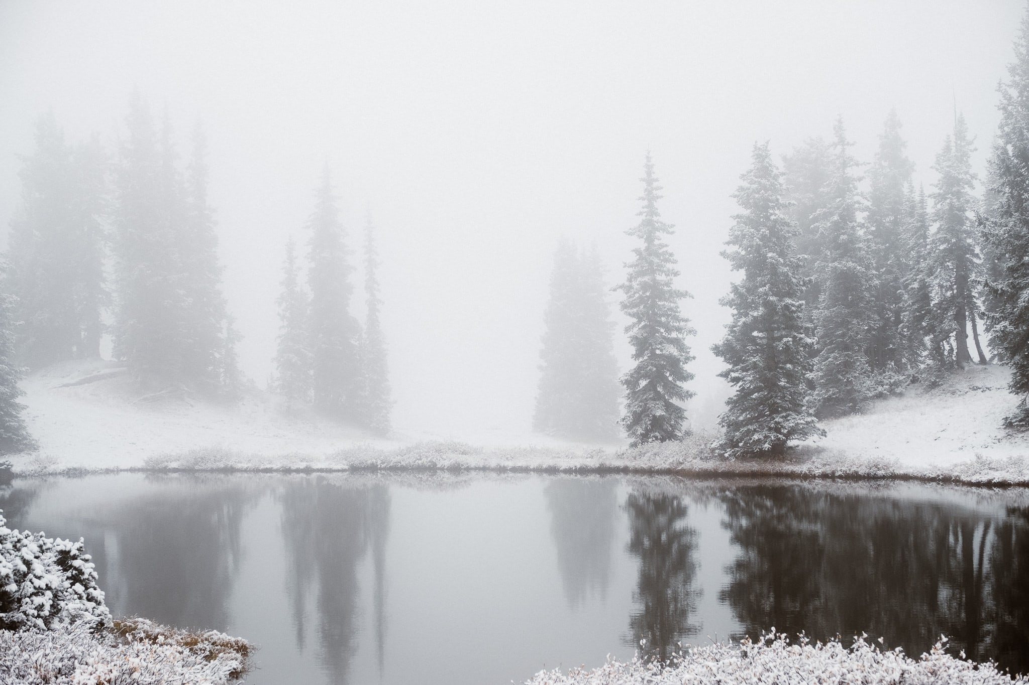 Crested Butte alpine lake mountain landscape in winter, moody winter landscape photography