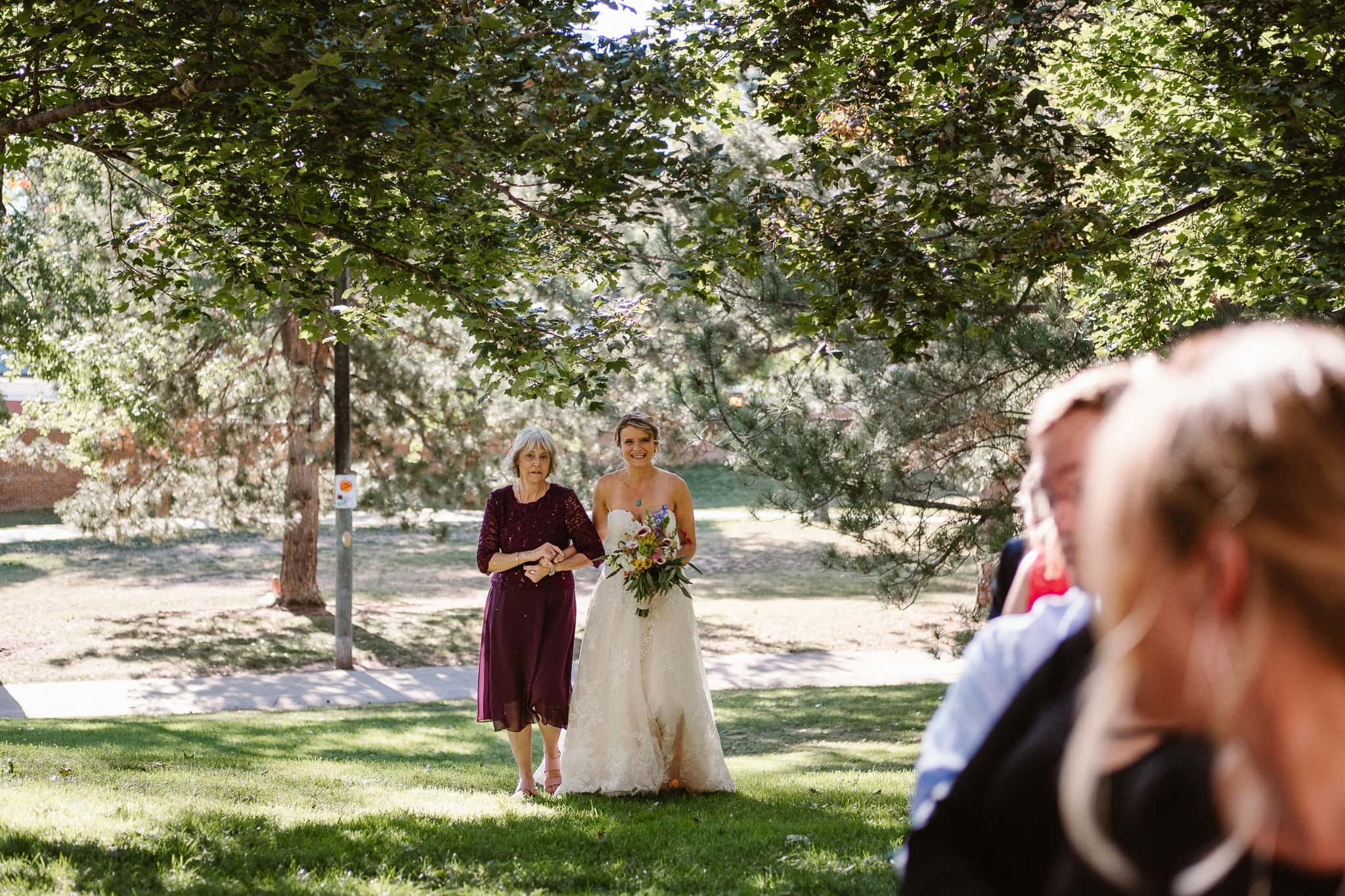 Grant Humphreys Mansion Wedding Photographer, Denver wedding photographer, Colorado wedding photographer, wedding ceremony, bride walking up aisle with her mother