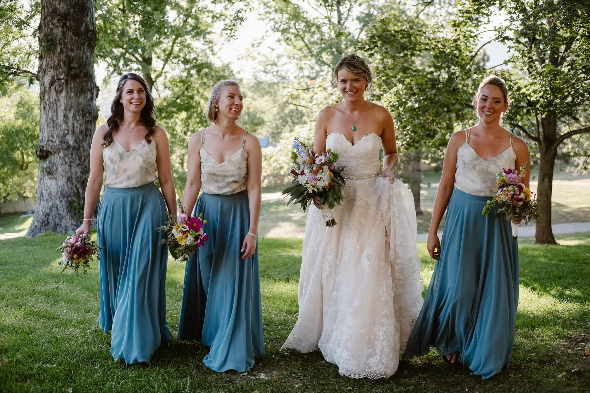 Grant Humphreys Mansion Wedding Photographer, Denver wedding photographer, Colorado wedding photographer, bride with bridesmaids, blue skirt and watercolor top bridesmaids outfits, Jenny Yoo bridesmaids