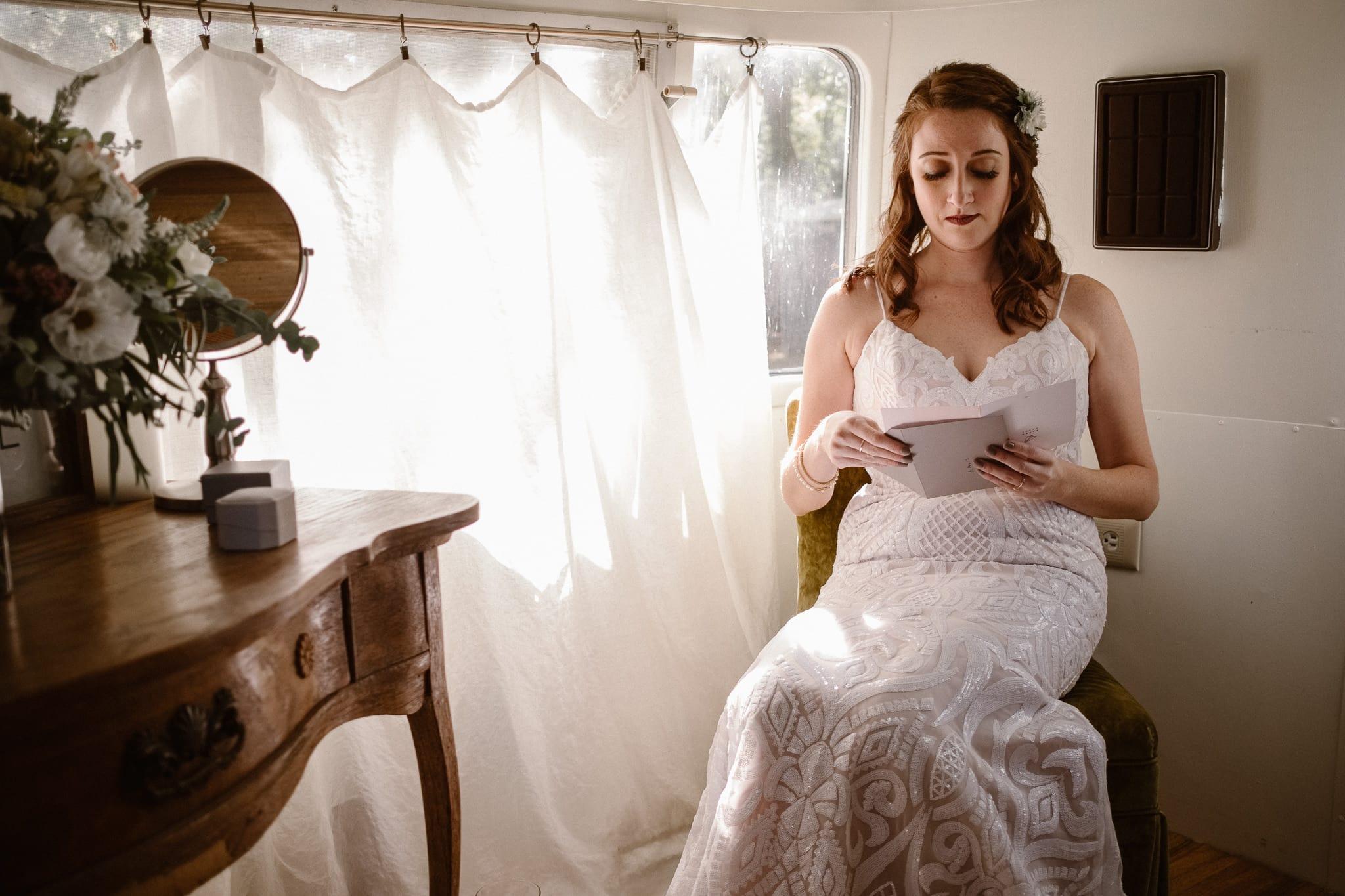 Lyons Farmette wedding photographer, Colorado intimate wedding photographer, bride getting ready in airstream, bride reading letter