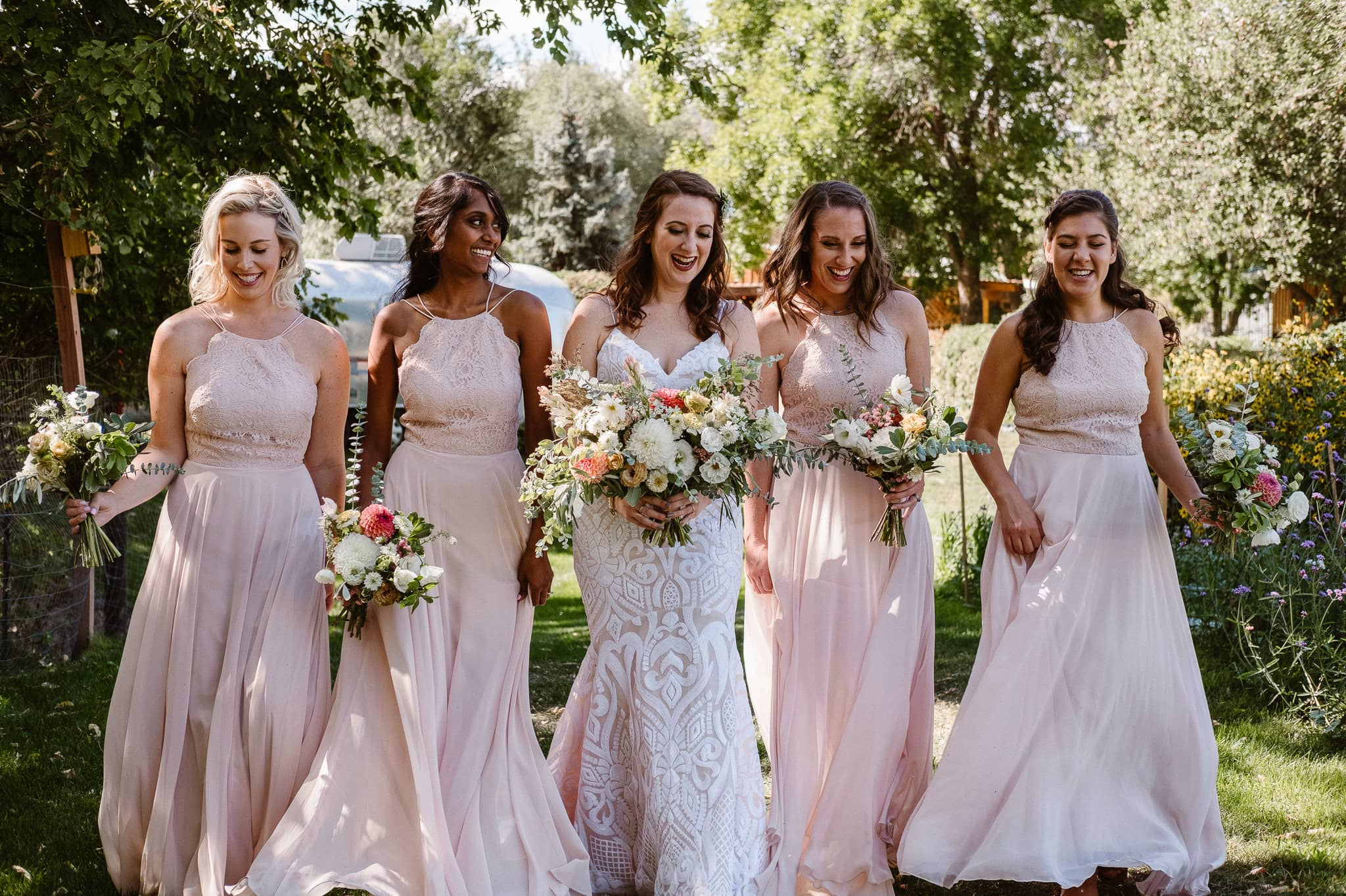 Lyons Farmette wedding photographer, Colorado intimate wedding photographer, bride and bridesmaids in flower gardens, bridal party photos, wedding party photos, bridesmaids in dusty pink dresses, rue de seine wedding dress