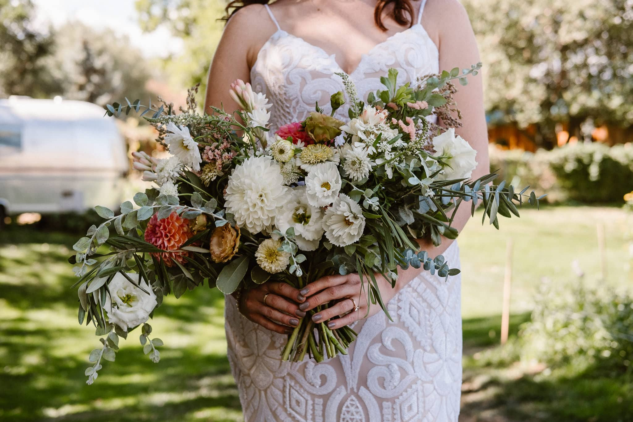 Lyons Farmette wedding photographer, Colorado intimate wedding photographer, bride holding bouquet, wedding bouquet by Farmette Flowers, large cascading bouquet